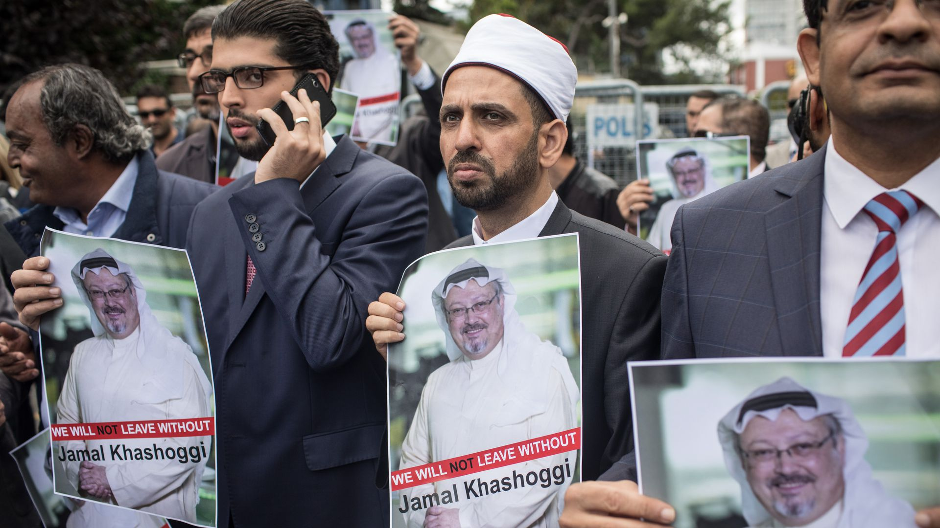 Protestors hold up signs for missing journalist Jamal Khashoggi