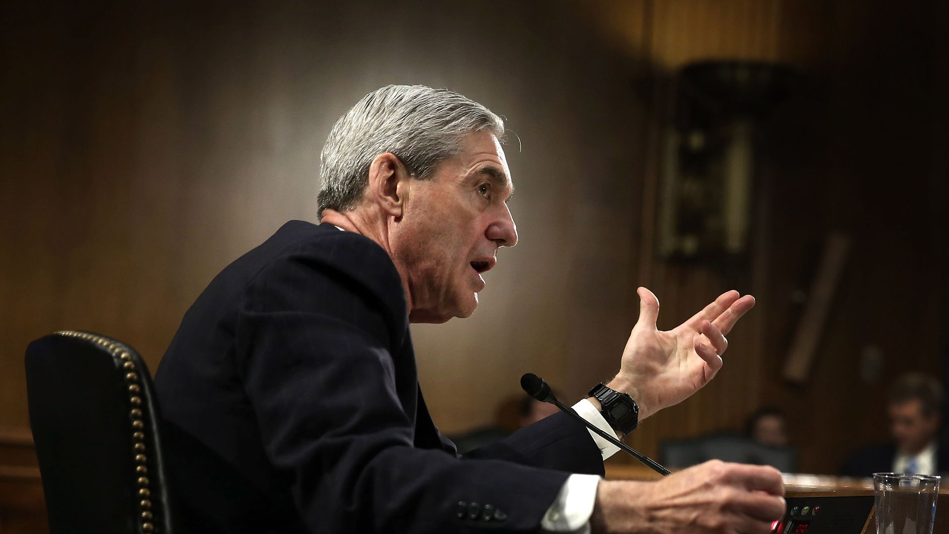 Robert Mueller sits at a table.