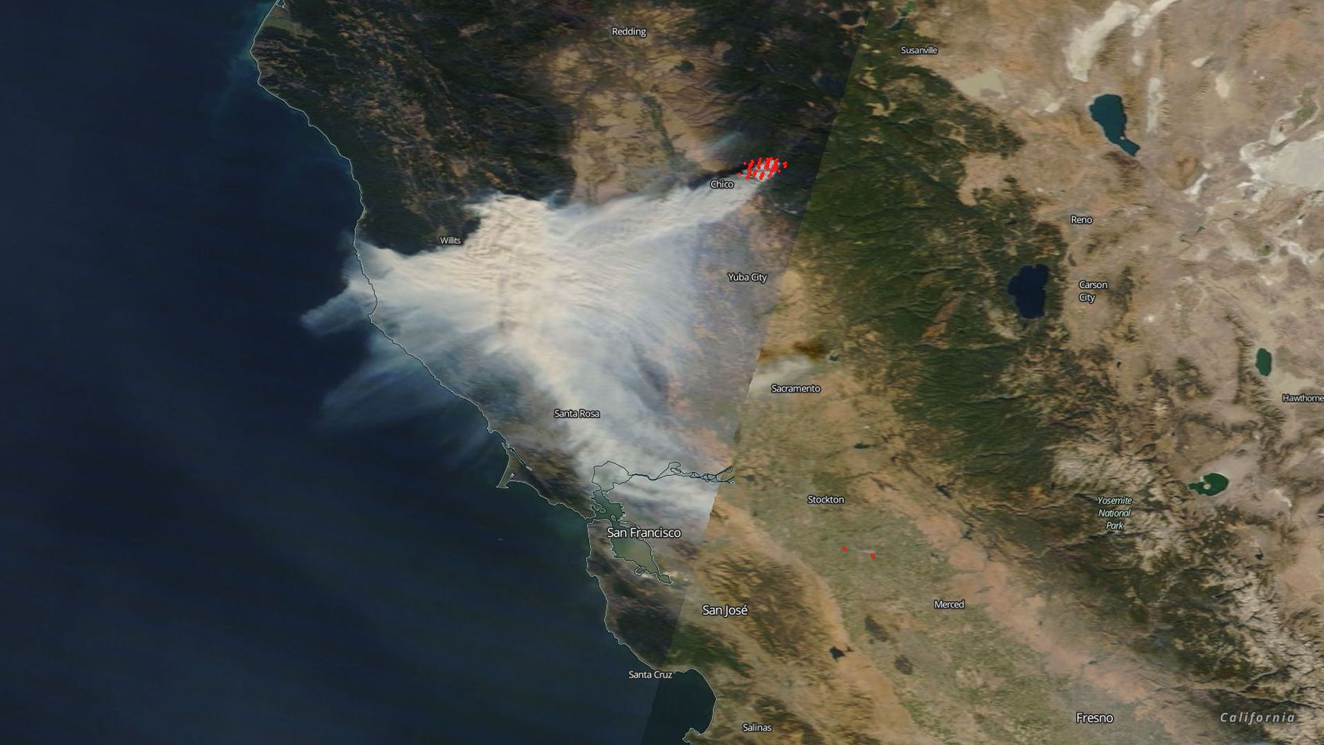 Satellite image showing the smoke plume from the Camp Fire (gray) and the heat signature of the fire (red dots) on Thursday afternoon. Credit: NASA MODIS.