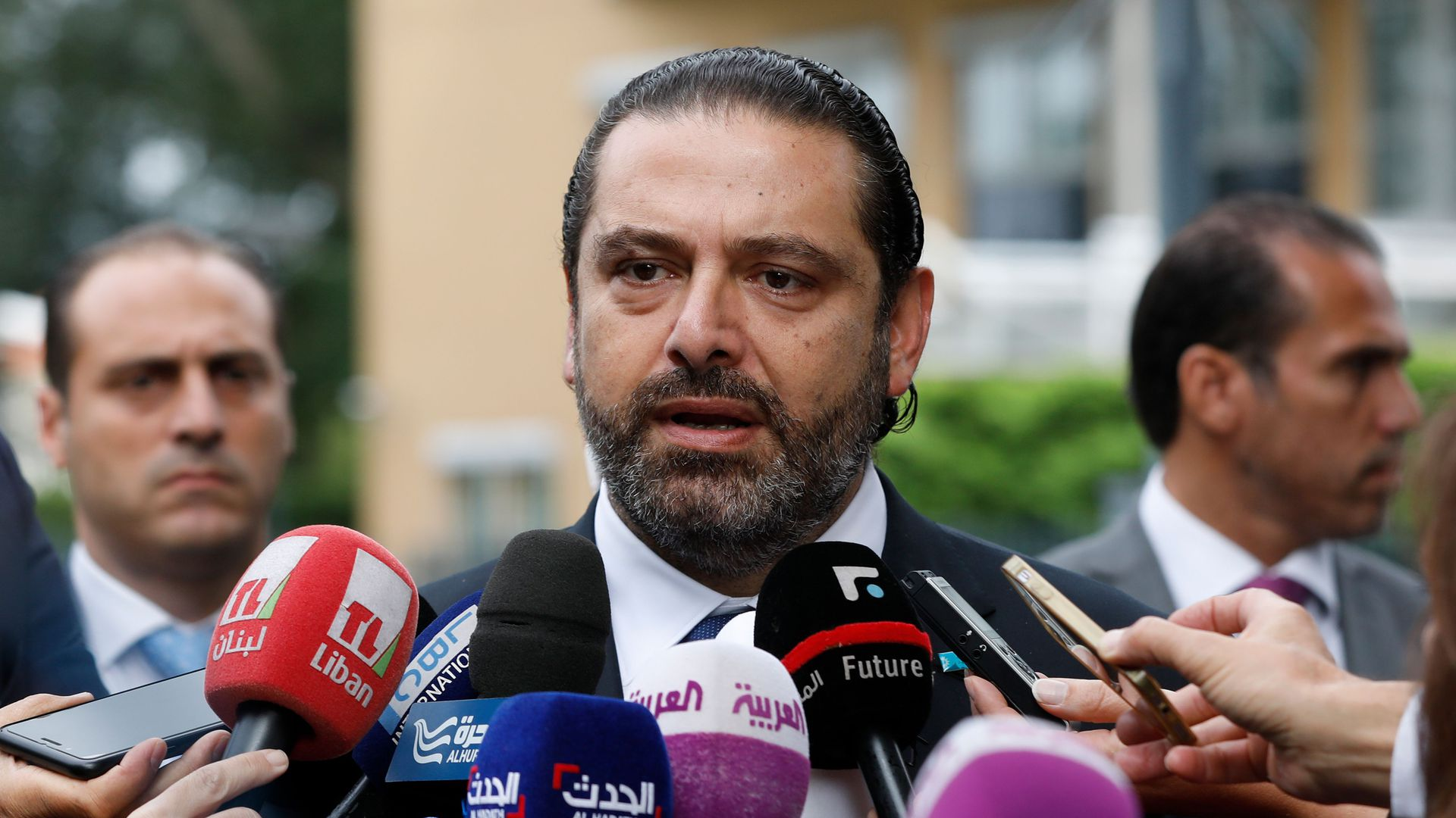 Lebanese premier-designate Saad Hariri speaks to the press in front of the Special Tribunal for Lebanon after the presentation of the closings arguments in the trial of four Hezbollah suspects