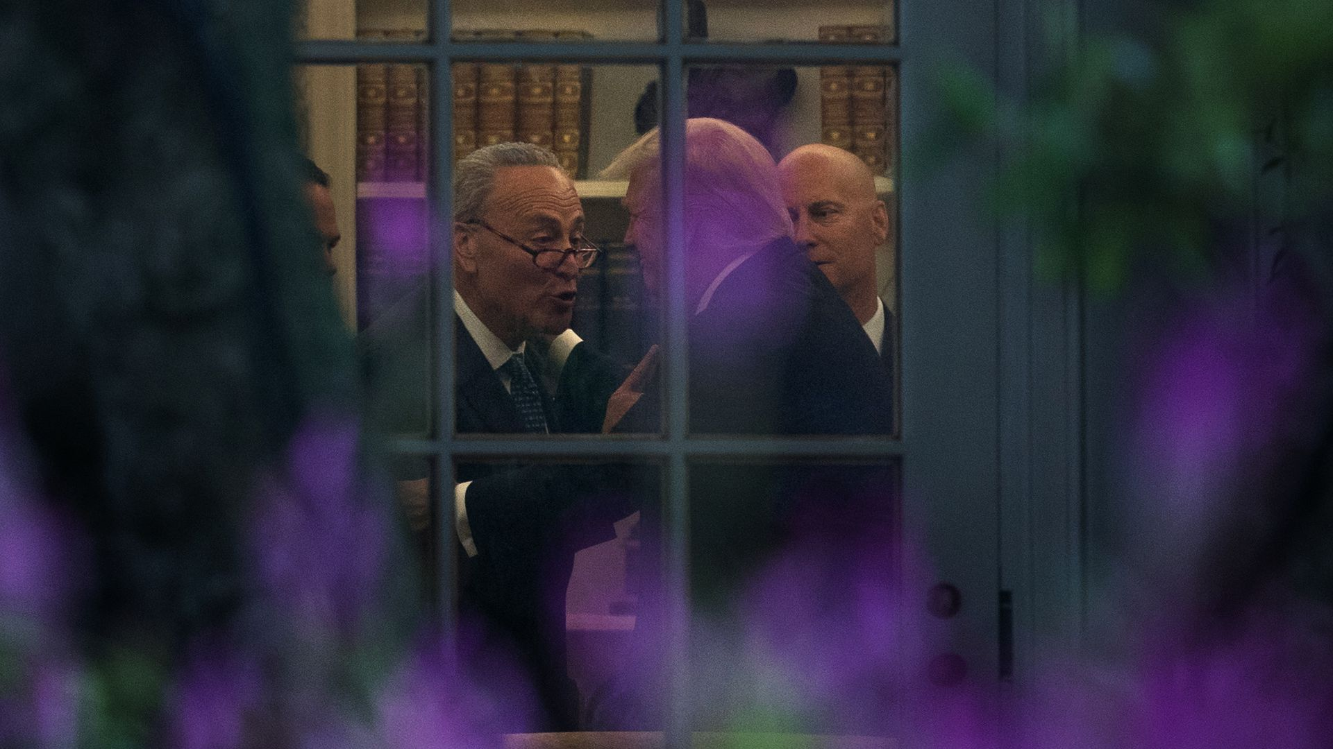 Schumer and Trump through the Oval Office window