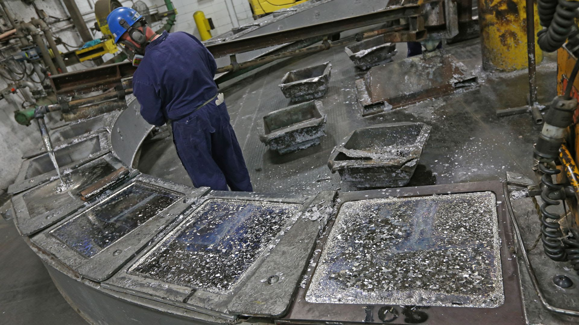 Gopher Resource employee pours melted lead from recycled batteries into ingots for reuse at a Gopher Resource plant.