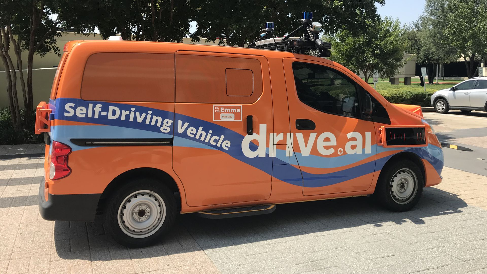 Photo of an orange self-driving van