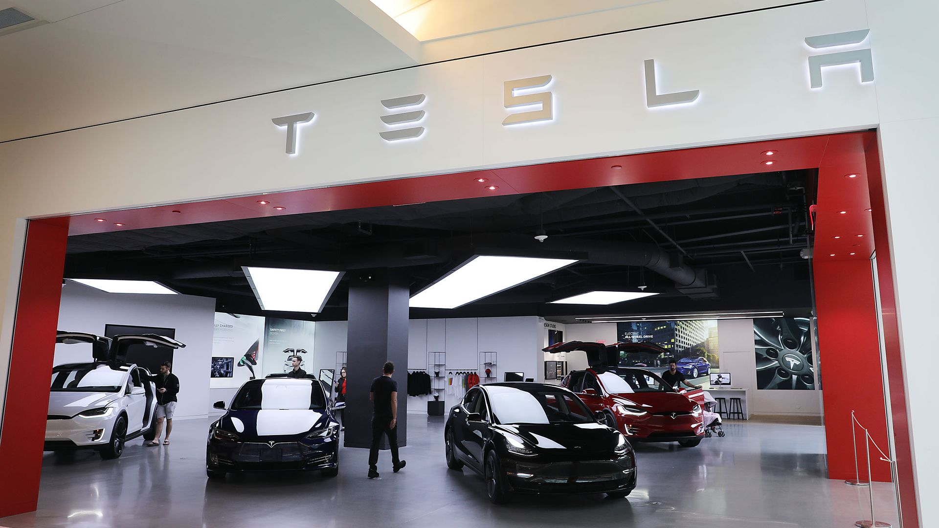 Photo of Tesla car showroom entrance with cars.