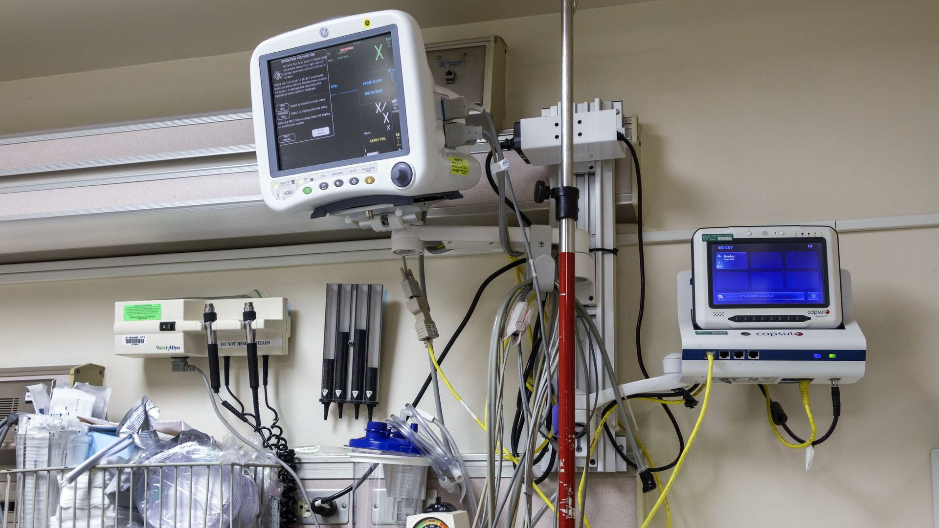 Medical equipment and monitors in a hospital emergency room.