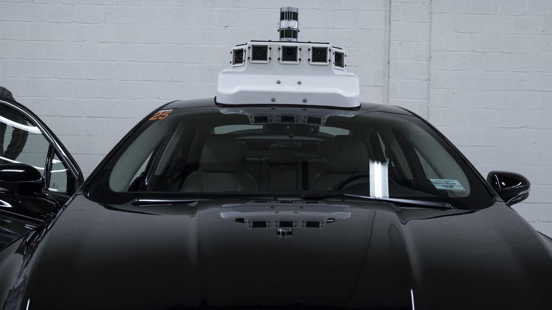 a black autonomous Ford sedan