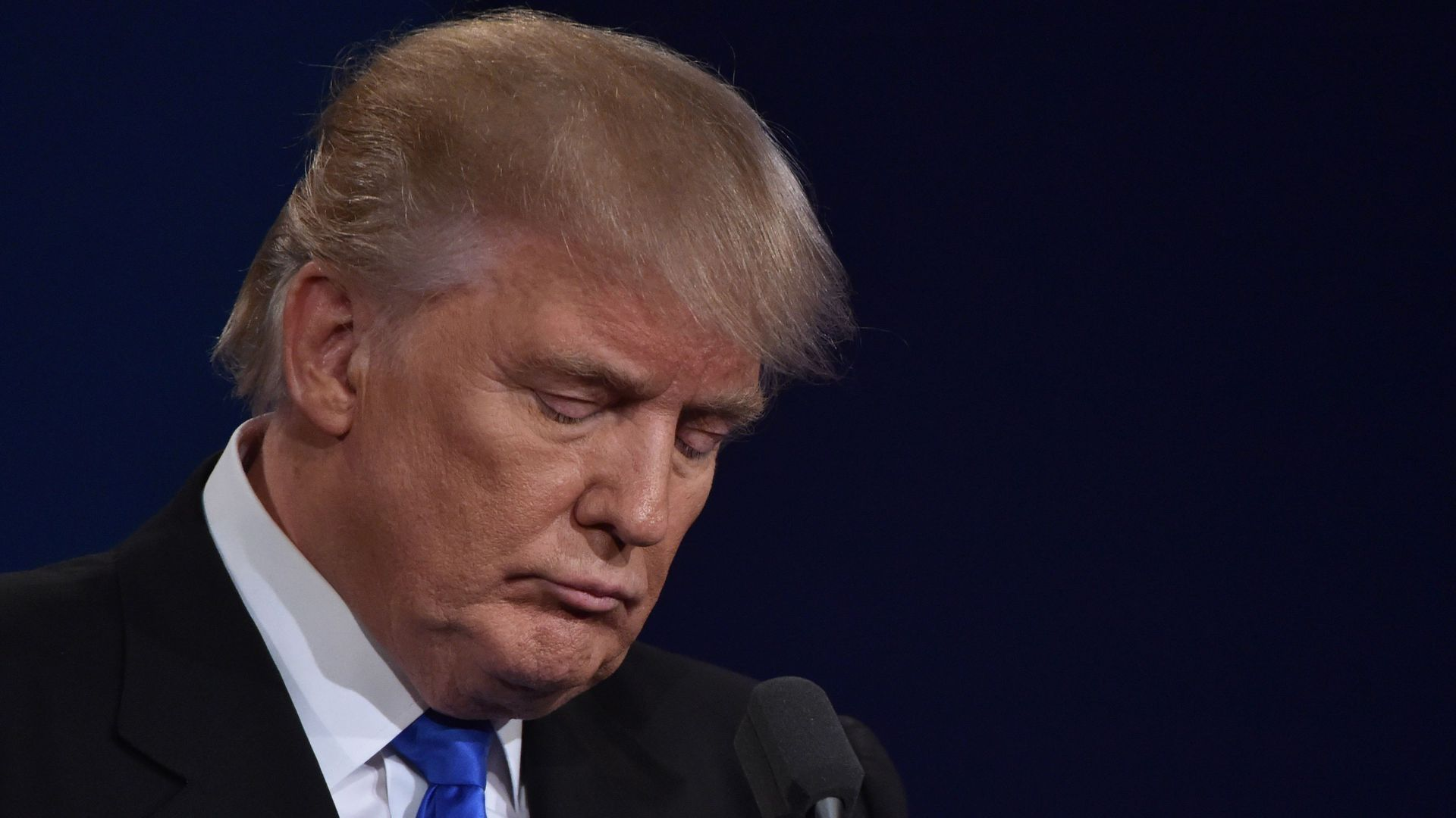 Donald Trump looking sad with his face down