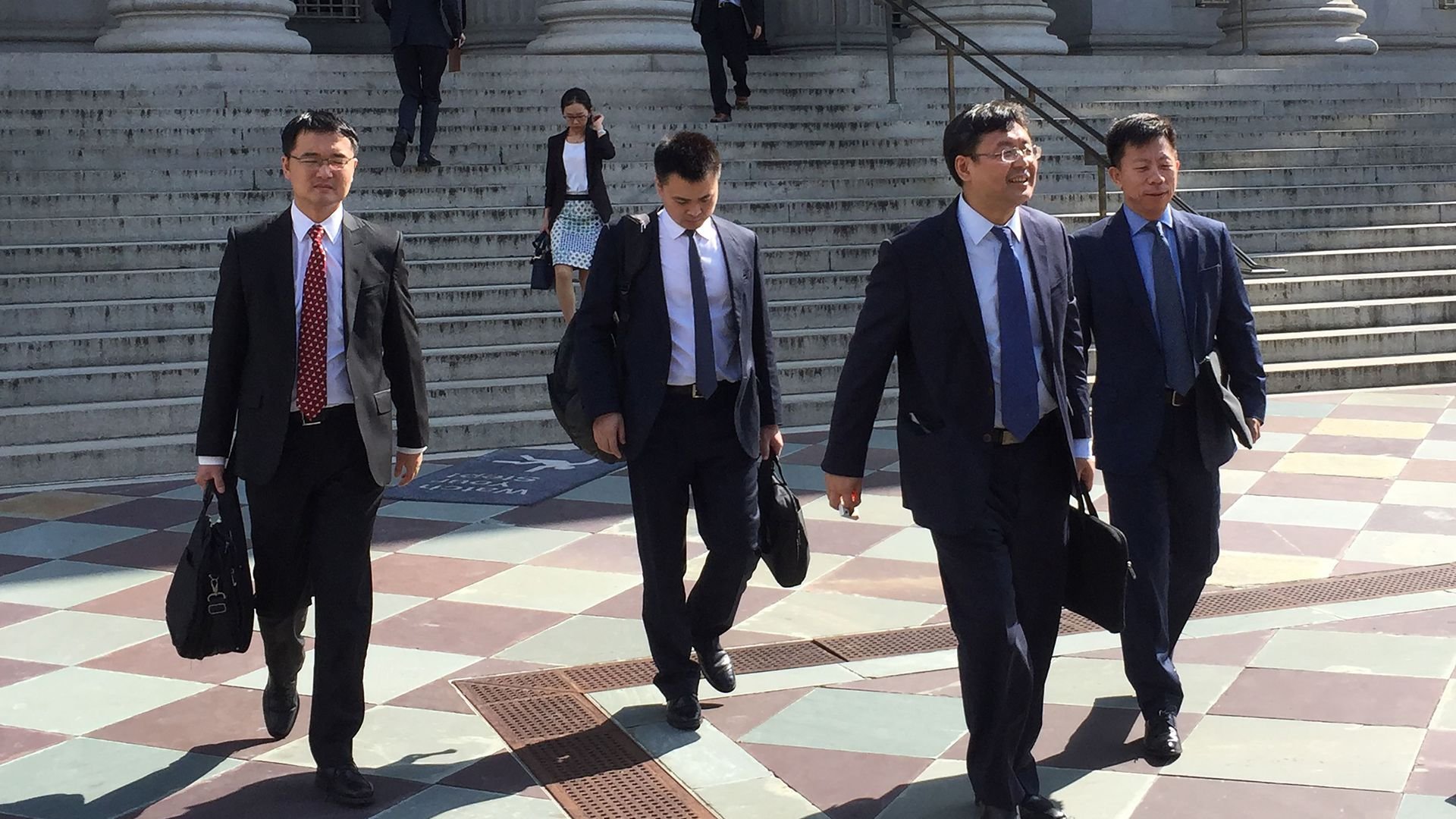 Photo of members of China trade delegation leaving unsuccessful meeting in D.C.