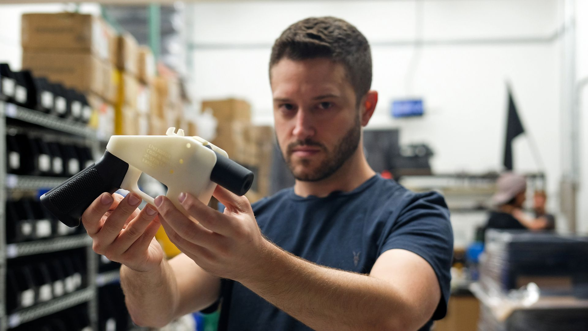 Cody Wilson holds up a 3D-printed gun