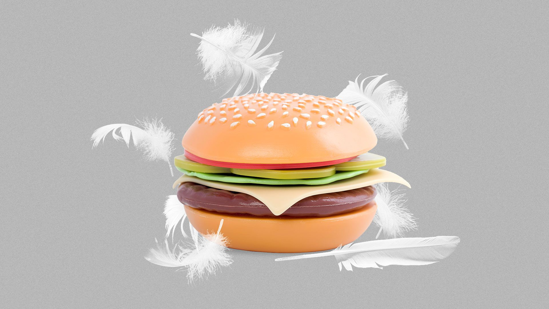 Illustration of a plastic hamburger surrounded by chicken feathers.