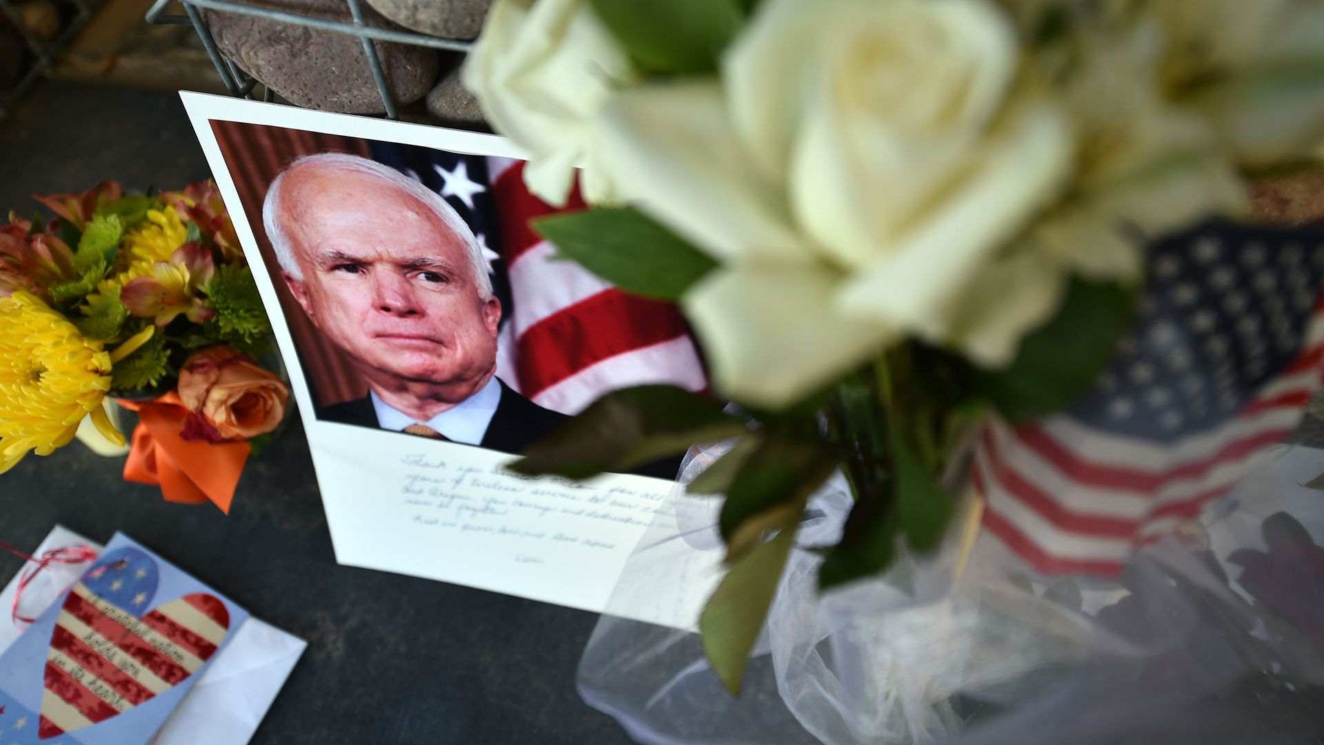 A makeshift memorial for Sen. John McCain outside his office in Phoenix, Arizona. Photo: Robyn Beck/AFP/Getty Images