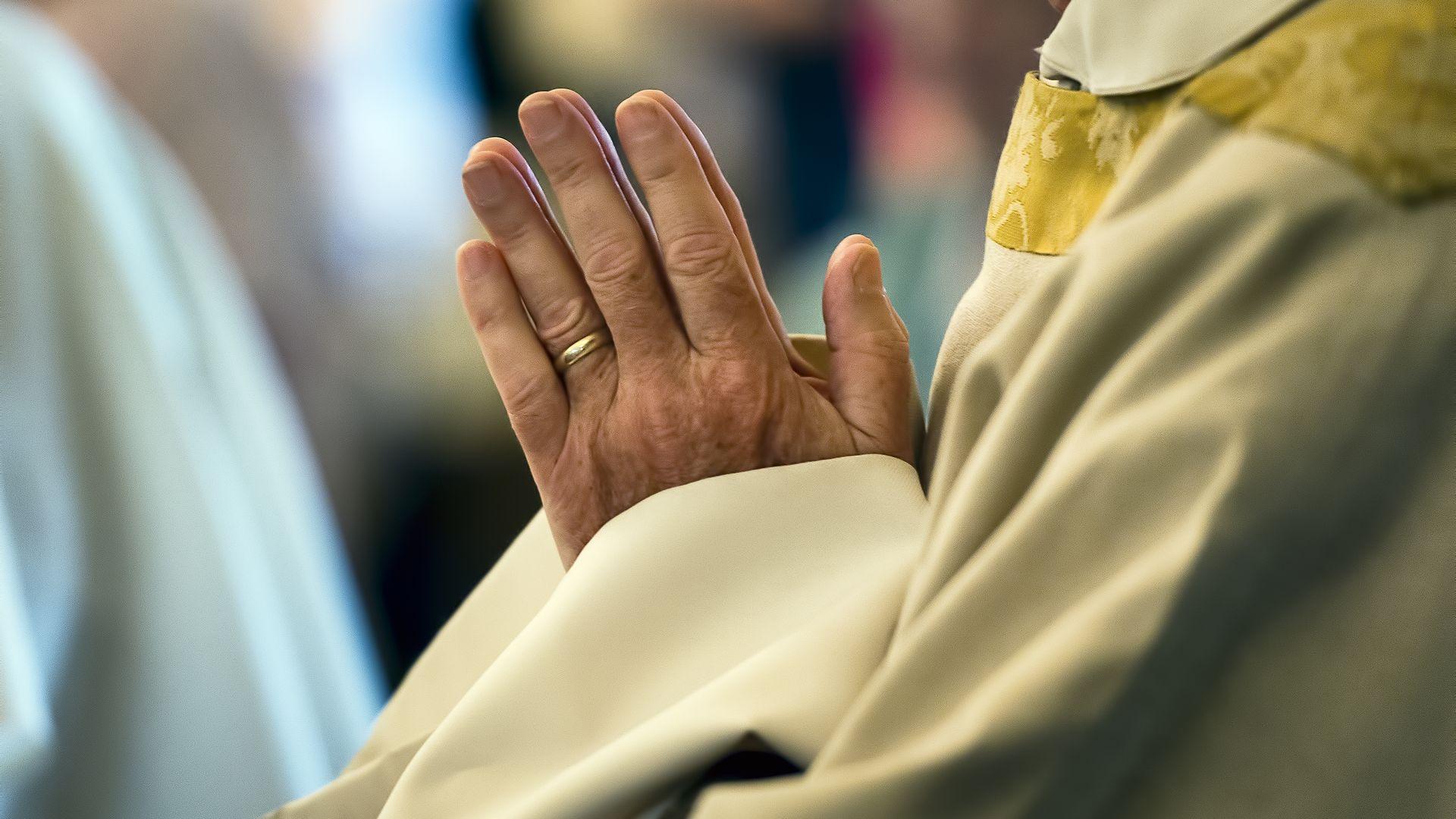 A priest's hands in prayer