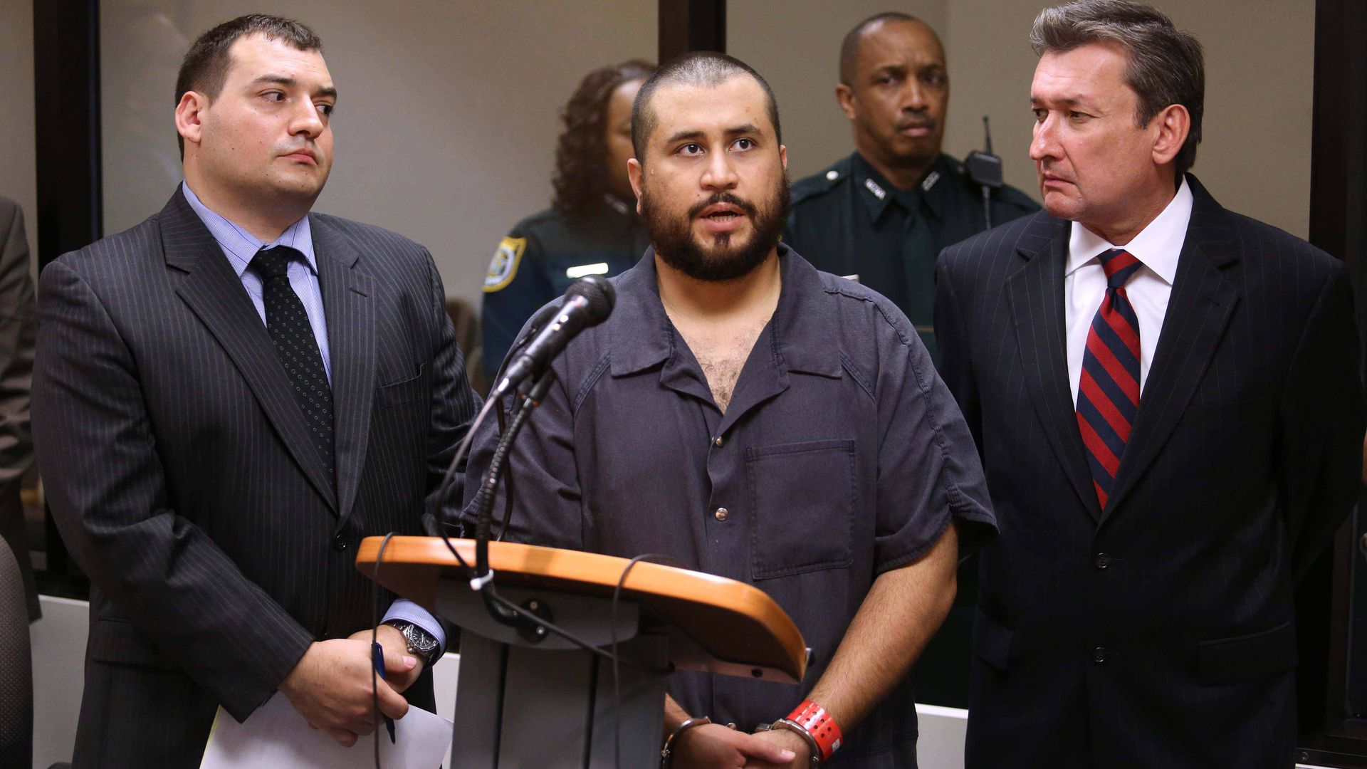 George Zimmerman answers questions from a Seminole circuit judge during a hearing on charges including aggravated assault stemming from a fight with his girlfriend November 19, 2013