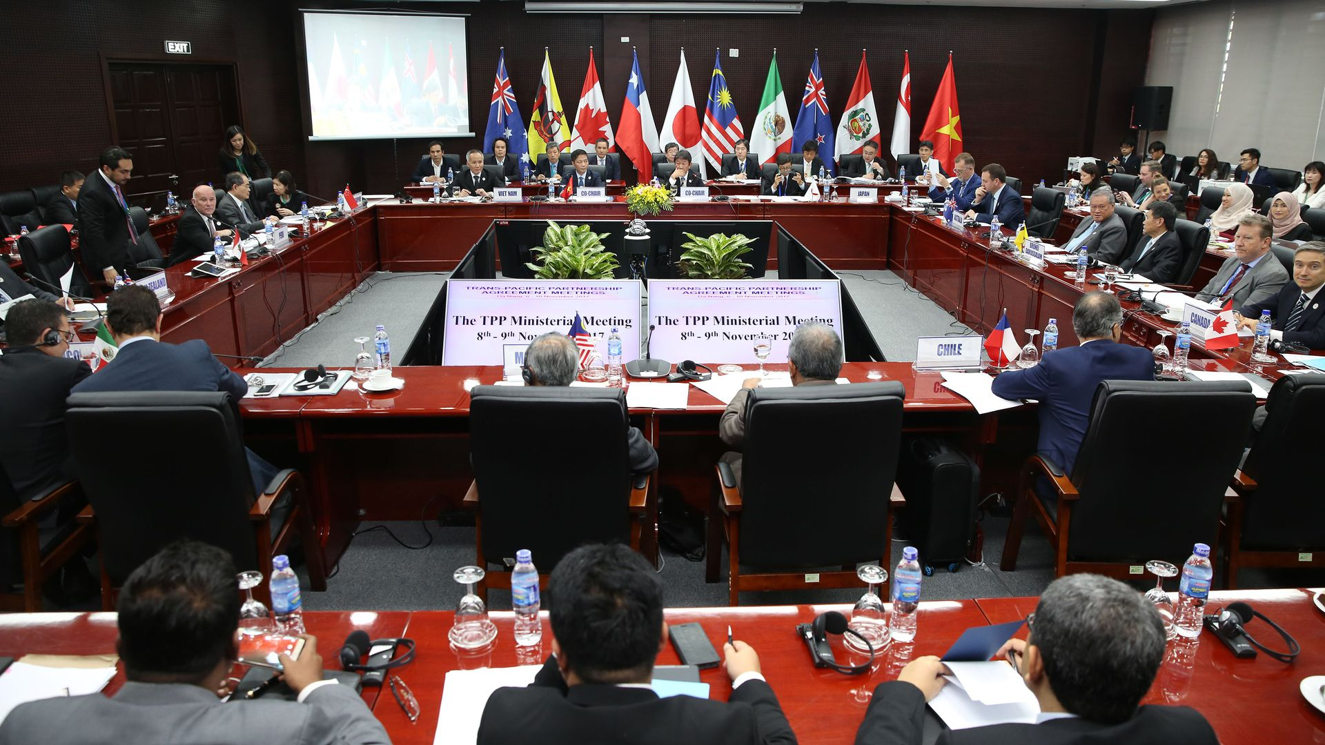 Asian trade delegates around a conference table