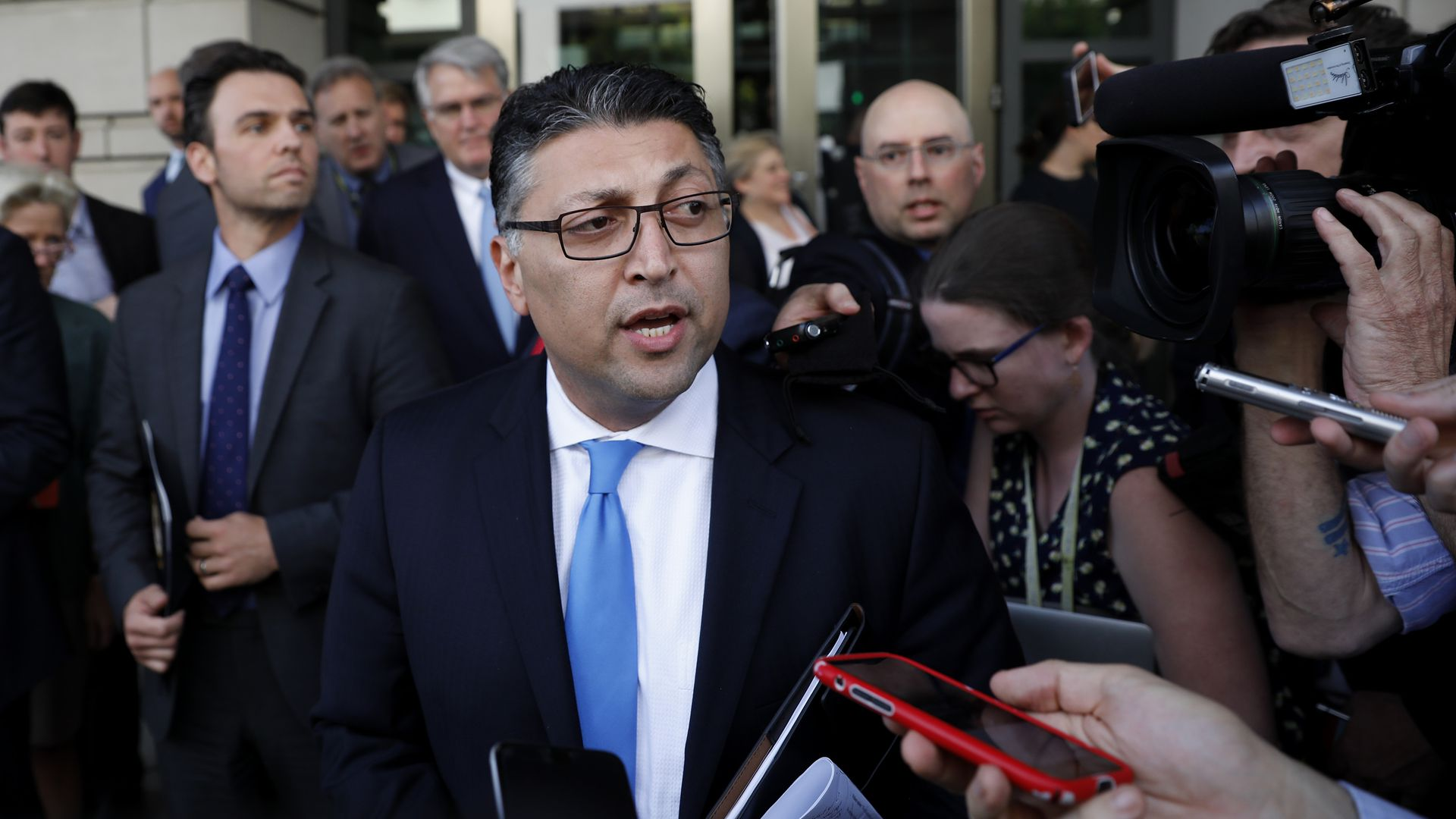 Justice Department antitrust chief speaks to reporters in a scrum