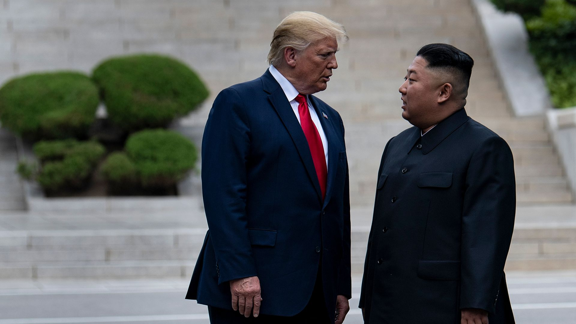 President Donald Trump and North Korea's leader Kim Jong-un stand on North Korean soil.