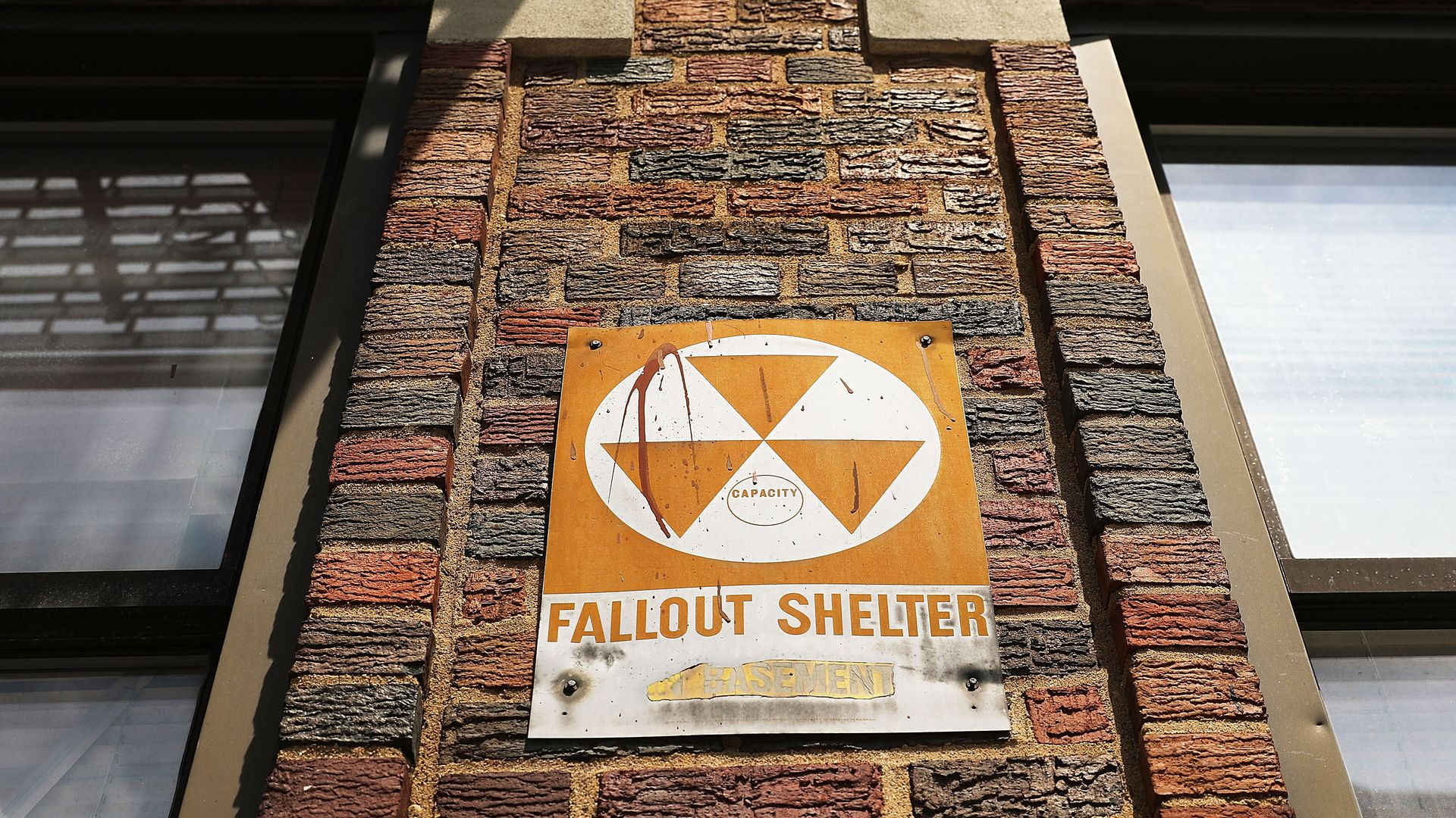 A leftover fallout shelter sign in New York City from the Cold War.