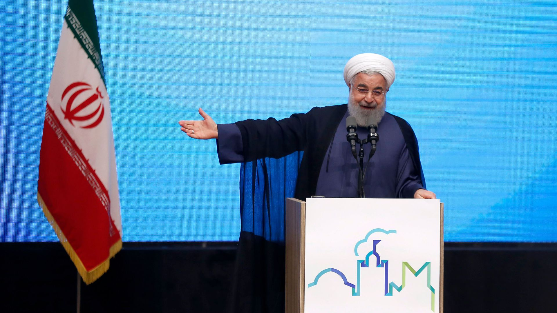 Rouhani pointing to Iran flag