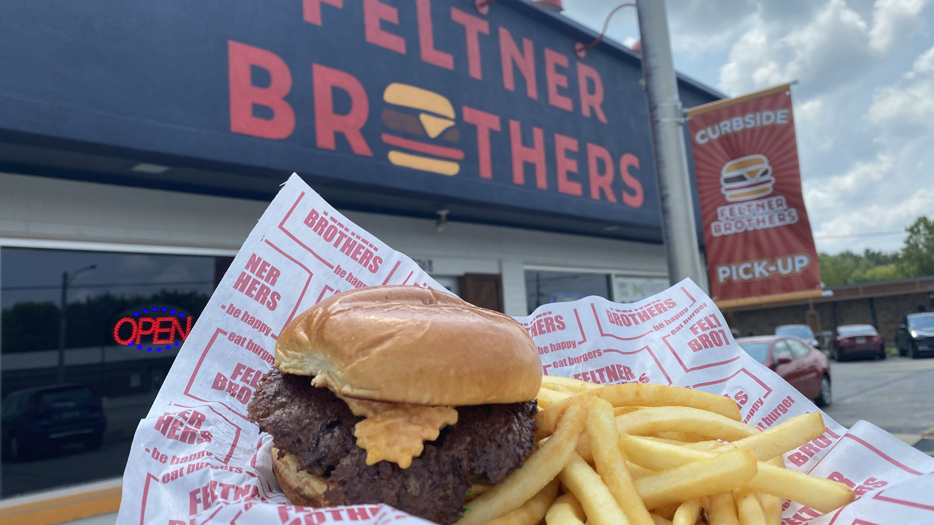 A photo of burger and fries in front of Feltner Brothers in Fayetteville, Ark.