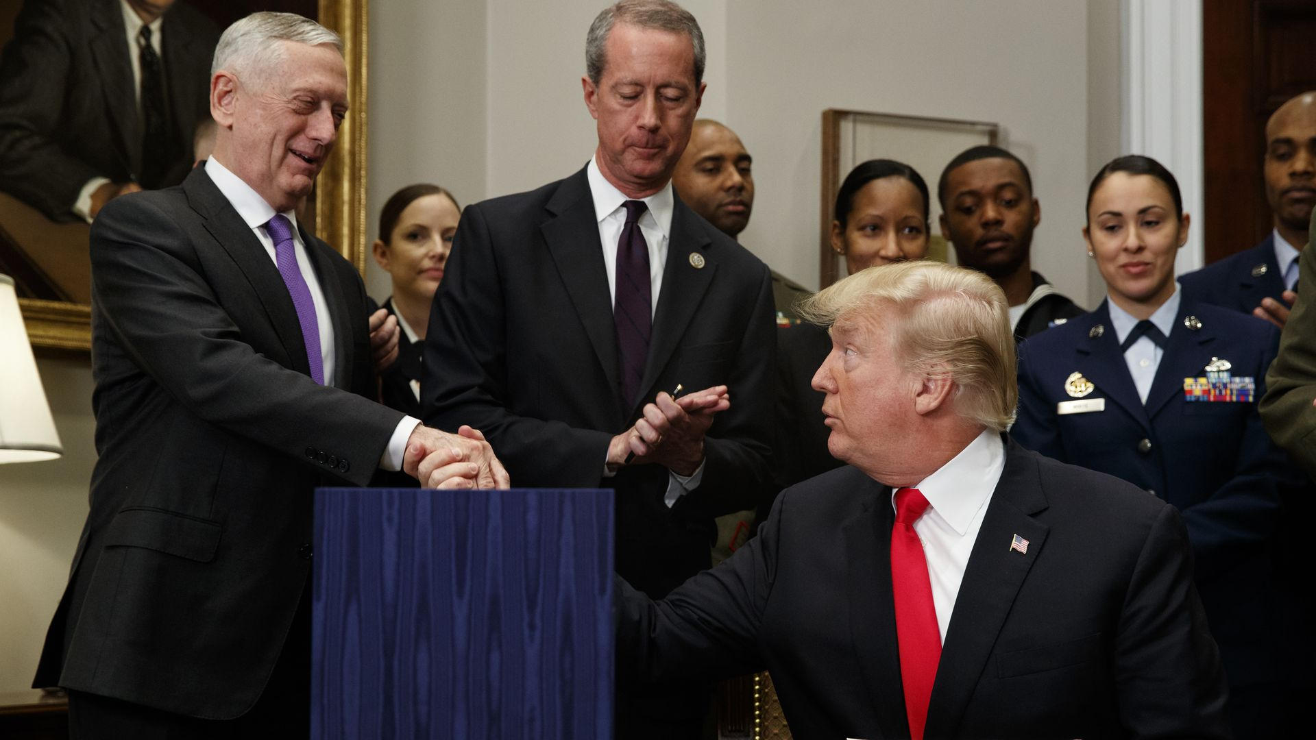 President Donald Trump shakes hands with Secretary of Defense Jim Mattis after signing the National Defense Authorization Act for Fiscal Year 2018.
