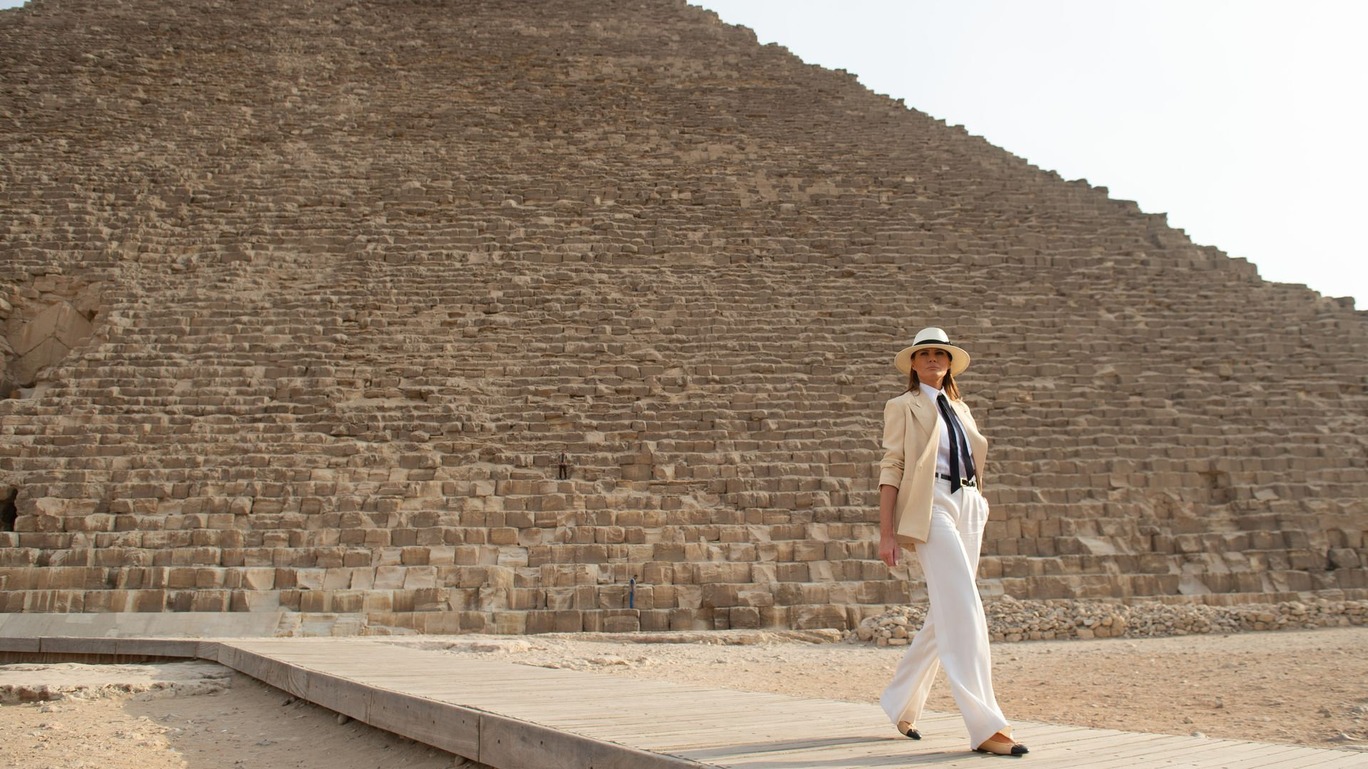 First Lady Melania Trump stands in front of the Great Pyramid in Giza, Egypt, October 6, 2018, the final stop on her 4-country tour through Africa.