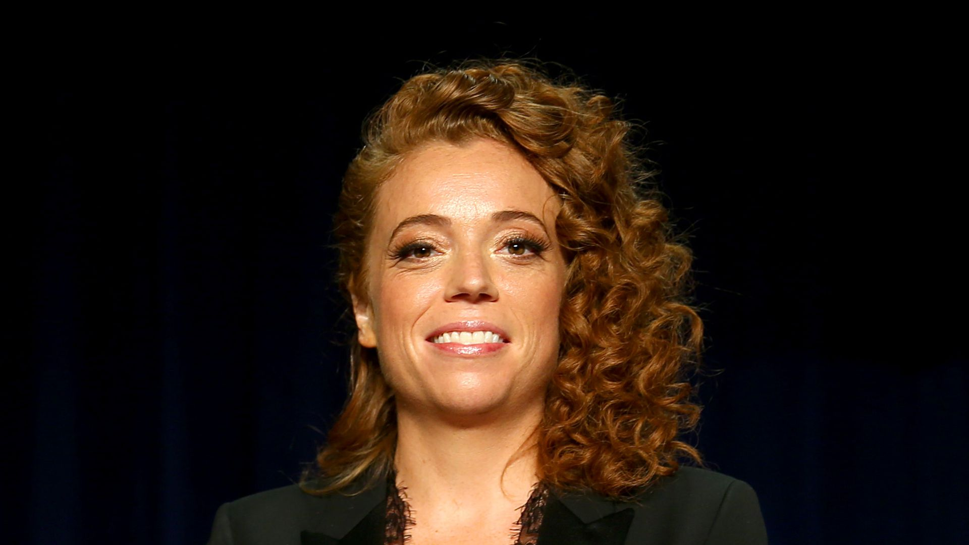 Comedian Michelle Wolf smiles at the camera