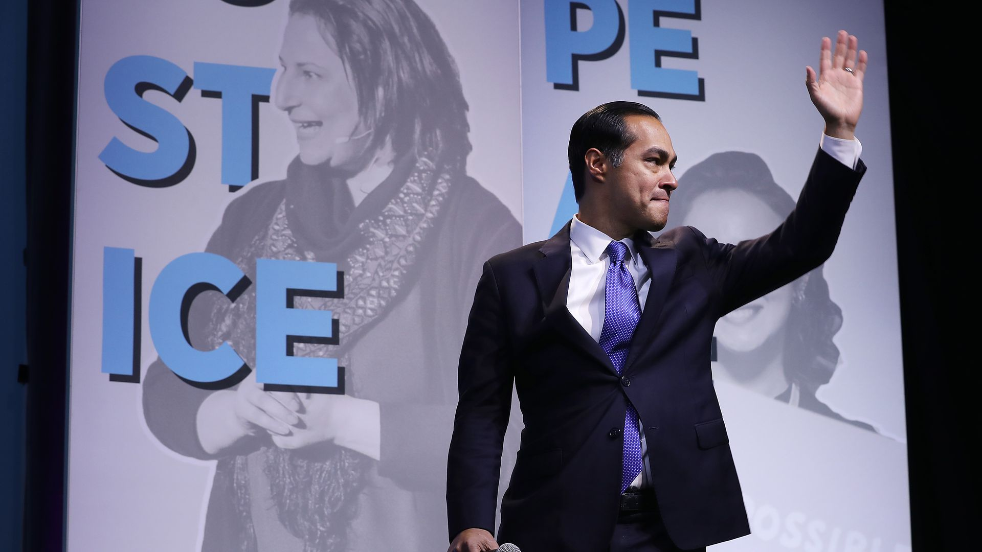 Julian castro waves at a crowd.