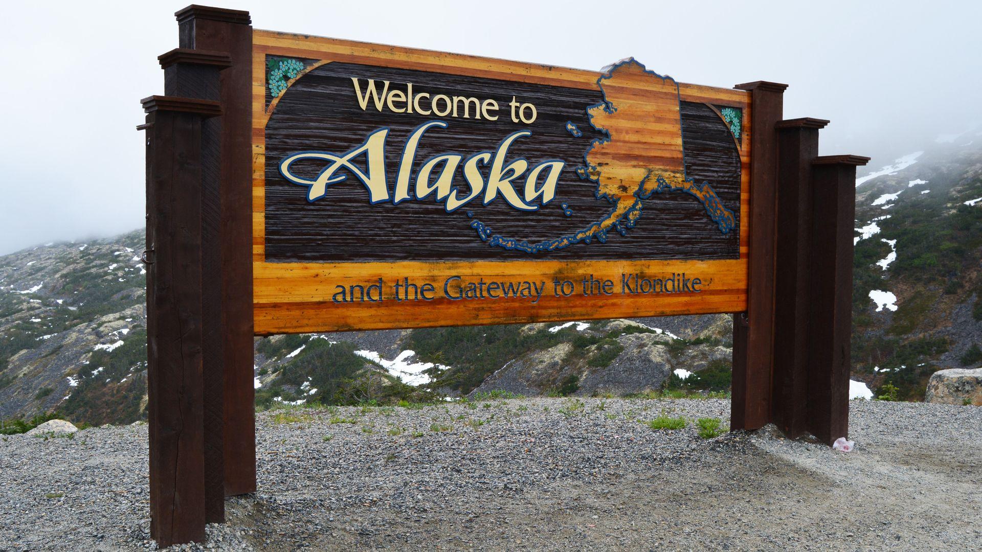 "A ""Welcome to Alaska"" sign"