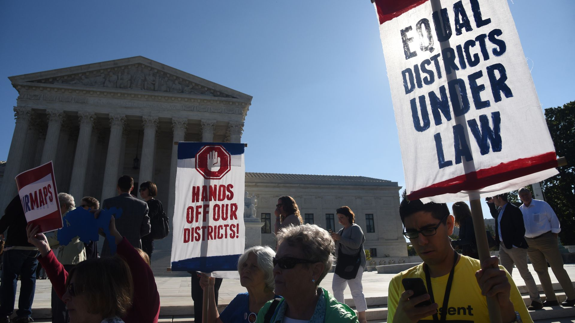 Demonstrators gather outside of The United States Supreme Court during an oral arguments in Gill v. Whitford last October.