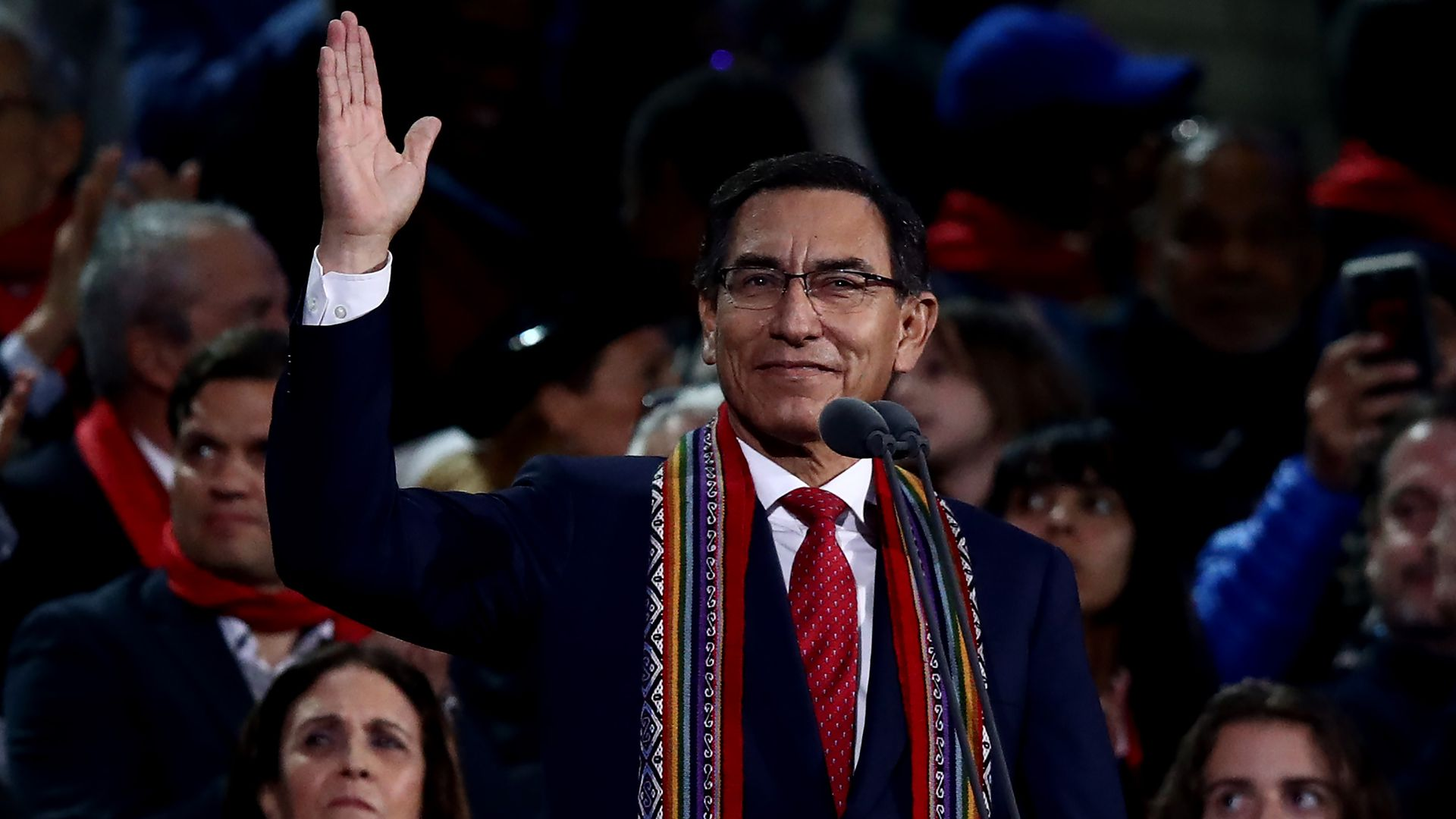 Martin Vizcarra waving in front of a stadium crowd