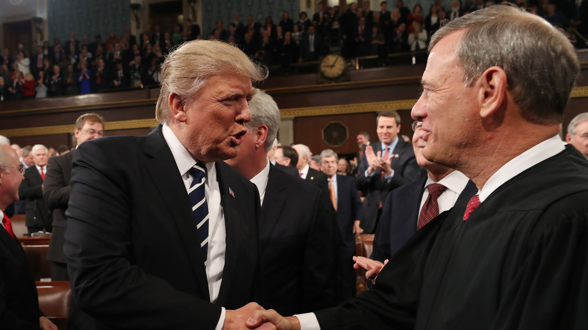 President Trump shakes hands with Chief Justice John Roberts