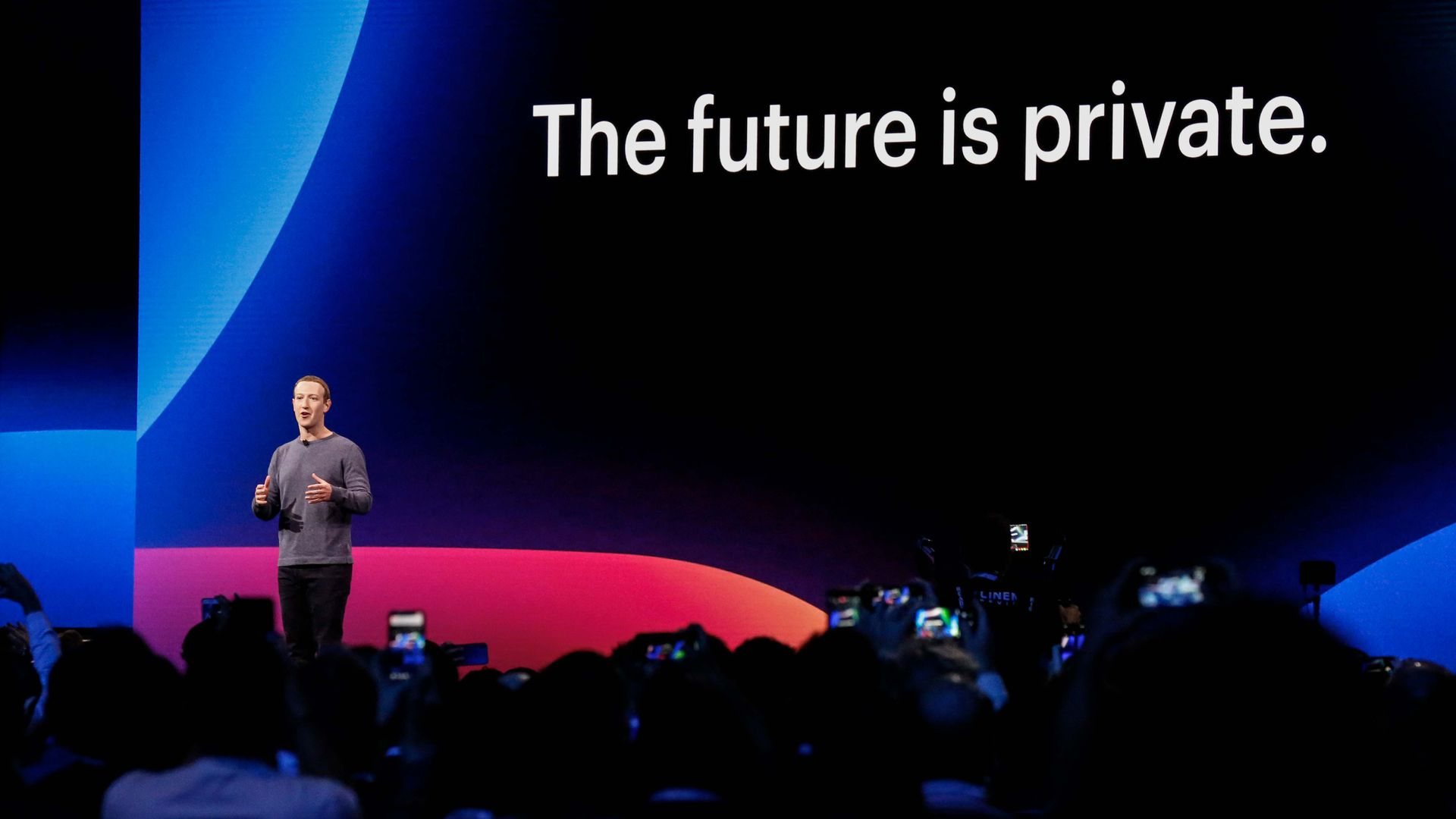 "Photo of Mark Zuckerberg on stage in front of a slide reading ""The future is private"""