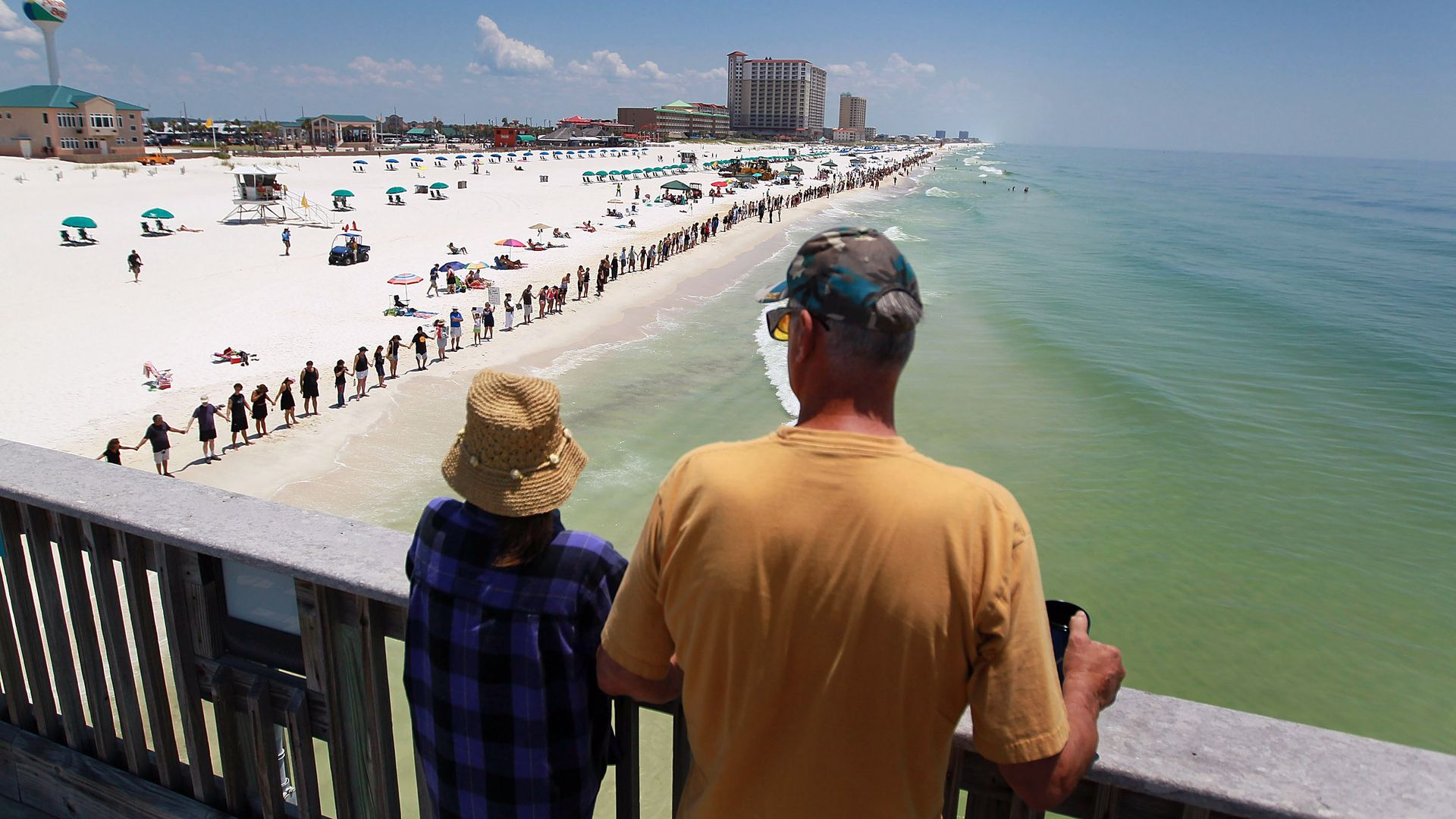 Line of people stretches across Pensacola beach in the June 2010 Hands Across the Sand protest against Deepwater Horizon oil spill