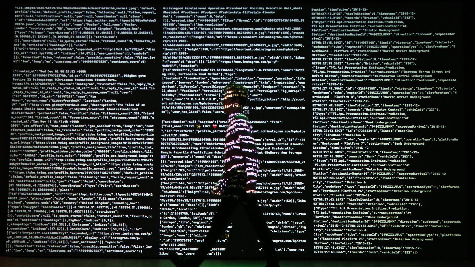 Man walking past data