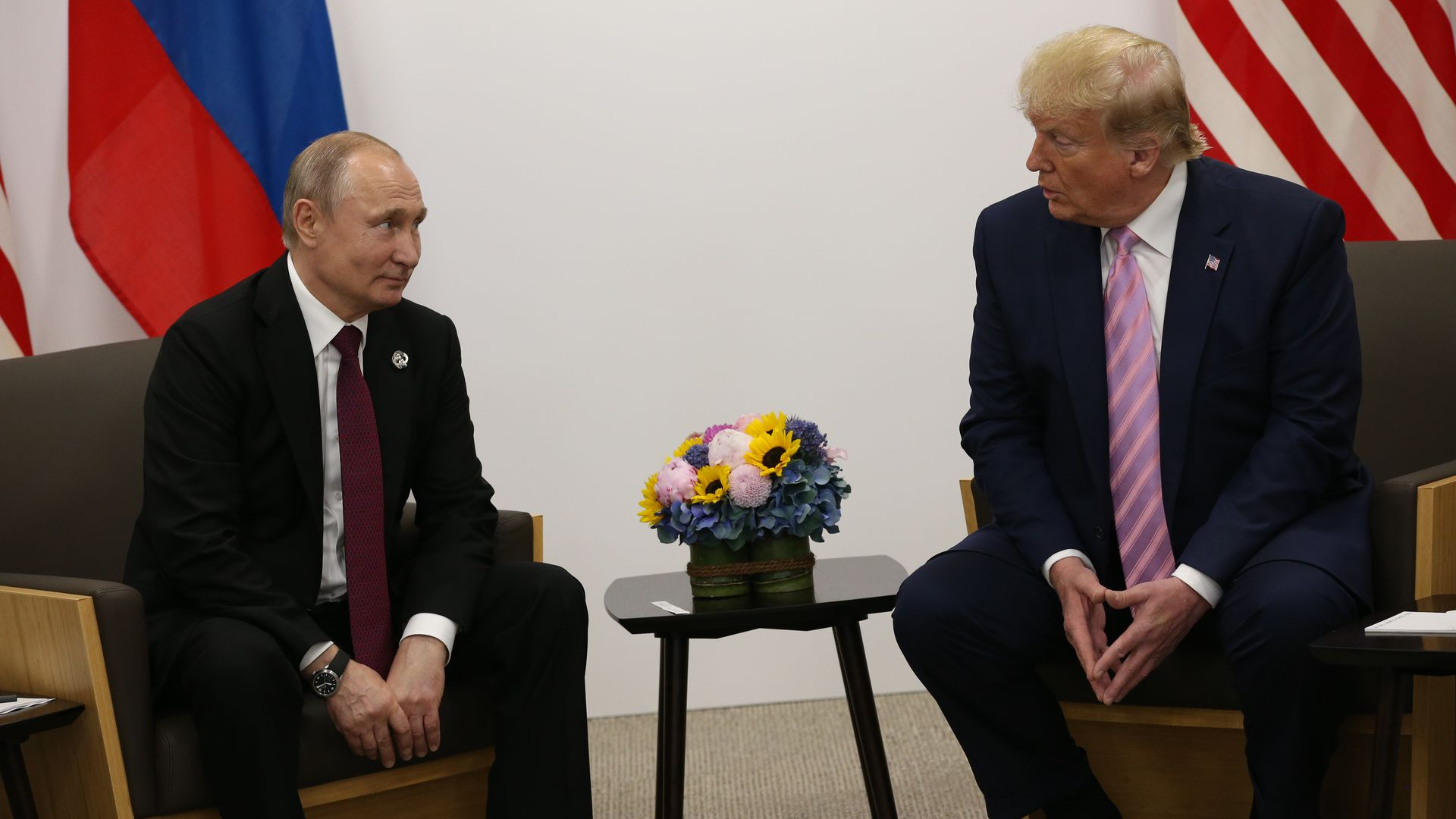 President Donald Trump (R) and Russian President Vladimir Putin (L) attend their bilateral meeting at the G20 Osaka Summit 2019, in Osaka, Japan