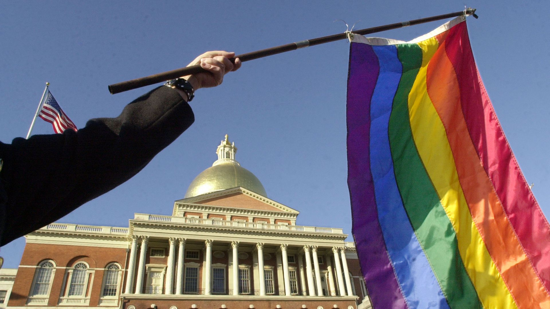 A supporter of gay marriage waves a rainbow flag outside the Massachusetts State House,