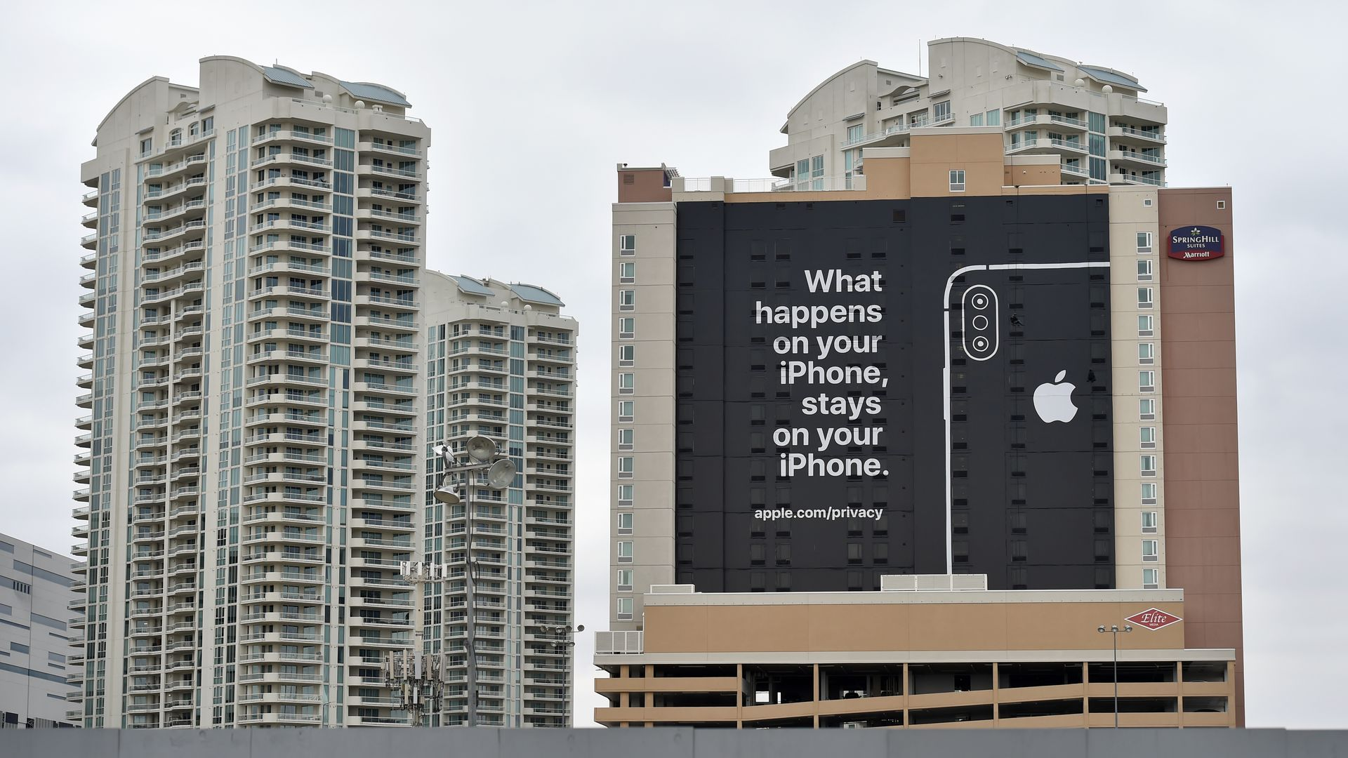 "Photo of Apple ad in Las Vegas for CES reading ""What happens on your iPhone stays on your iPhone"""
