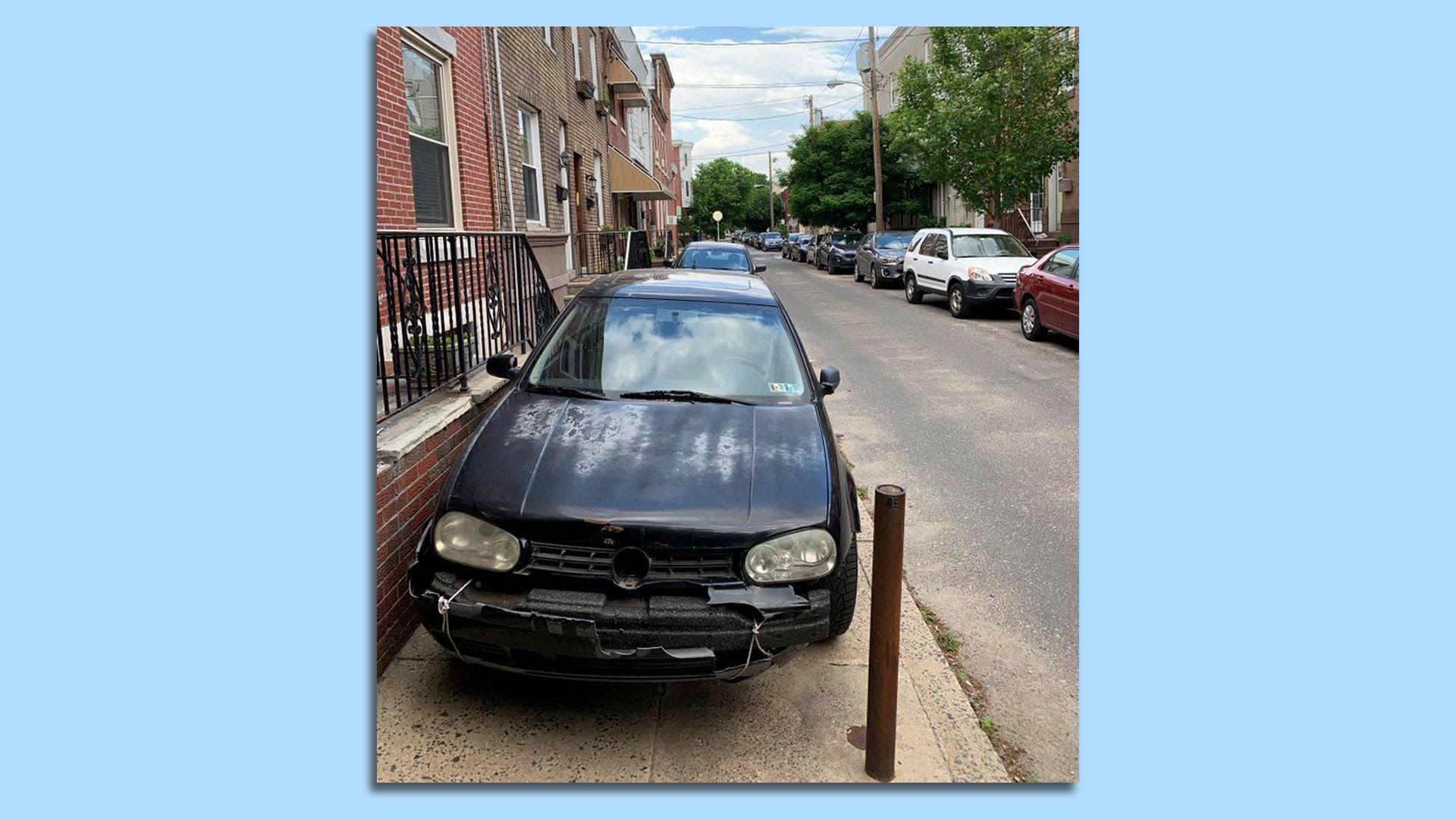 A car parks illegally on a curb in Philadelphia.
