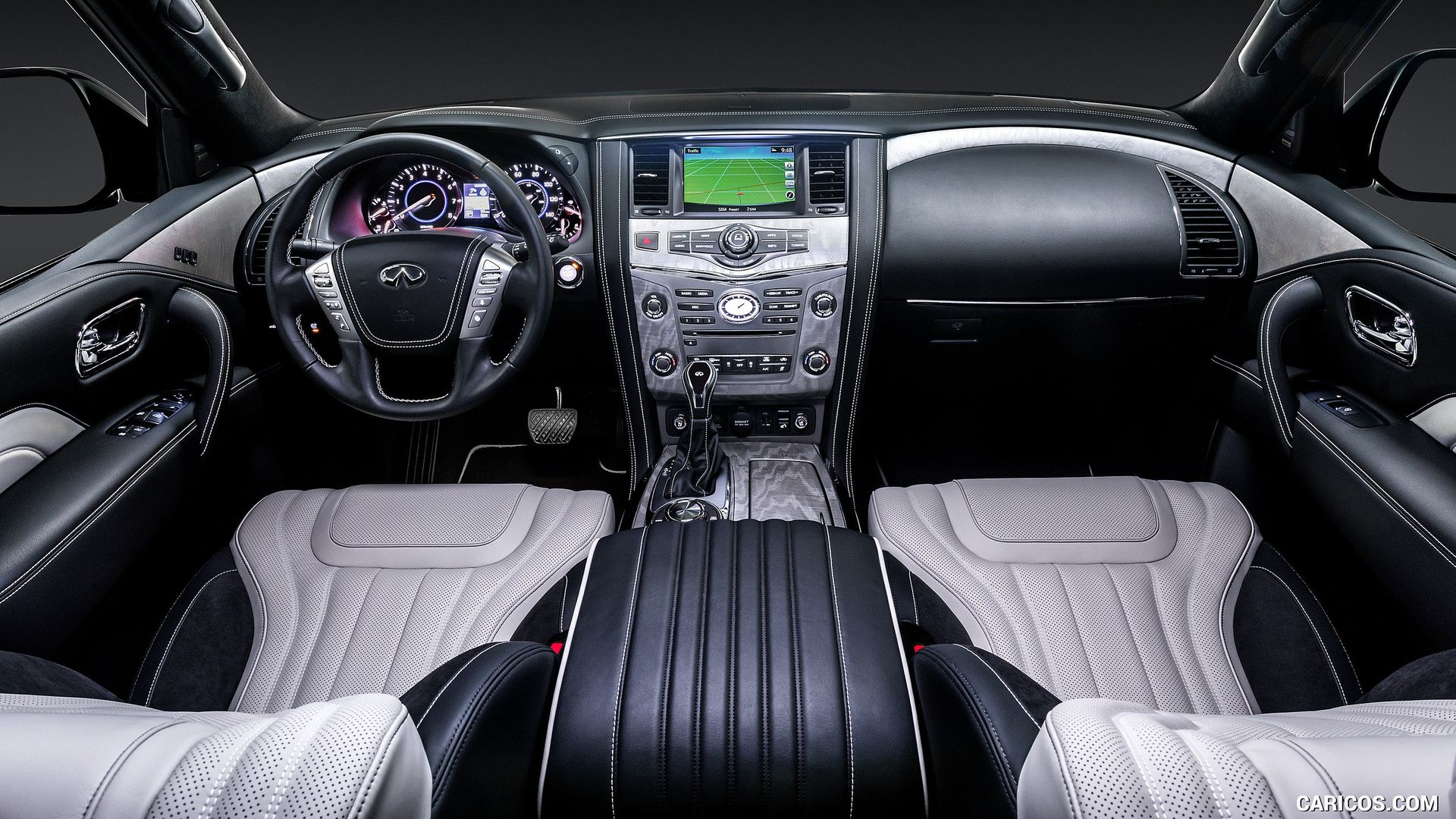 This image shows the black and gray interior of the Infiniti QX80.