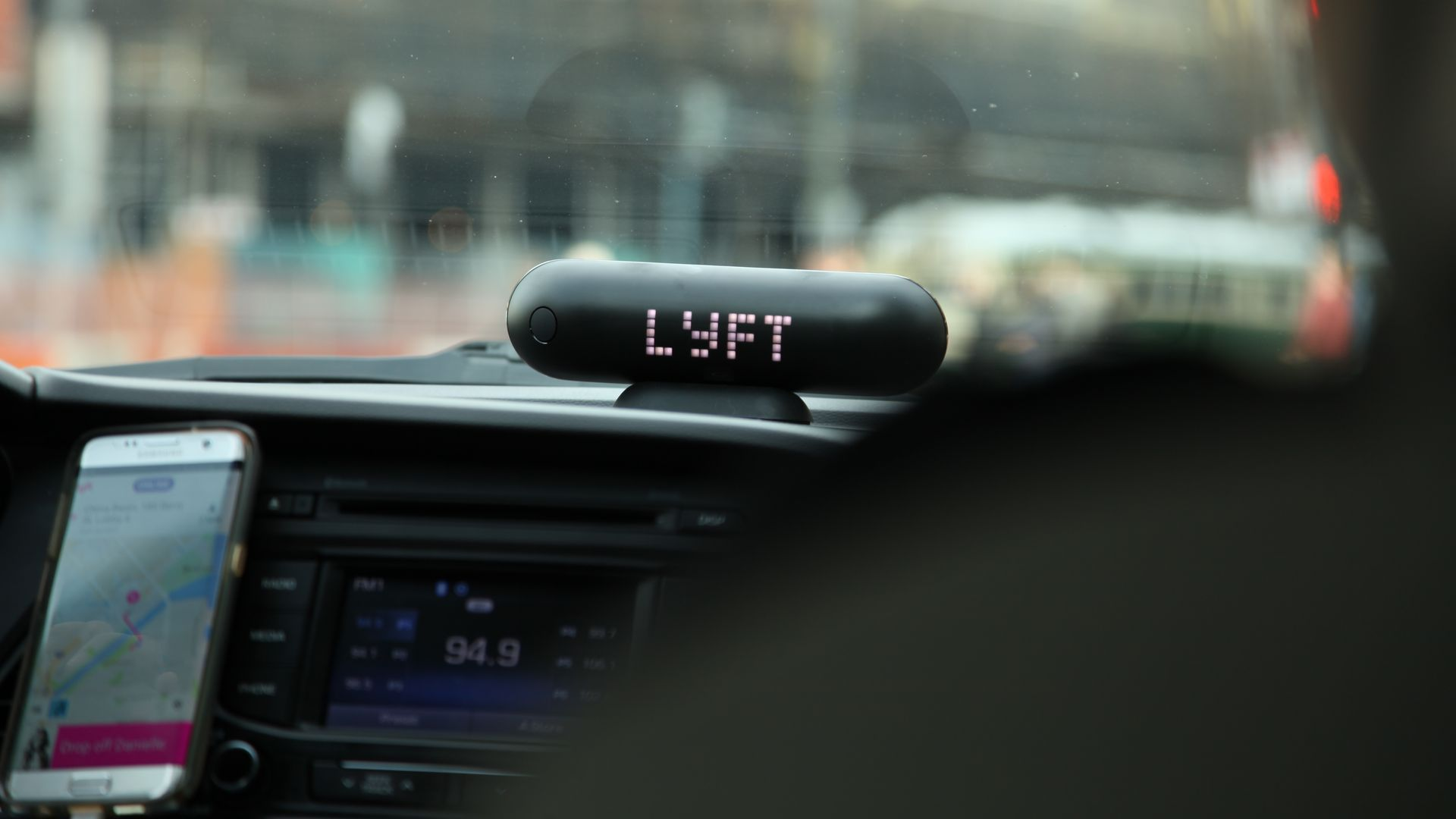 Car dashboard with lyft sign on it