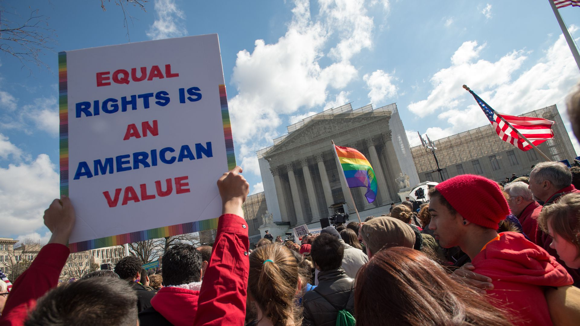 Supporters of LGBTQ rights rally outside the U.S. Supreme Court