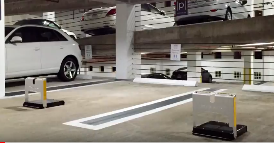 Screenshot from YouTube video of what the parking slot looks like with a block that goes up/down when reserved car arrives