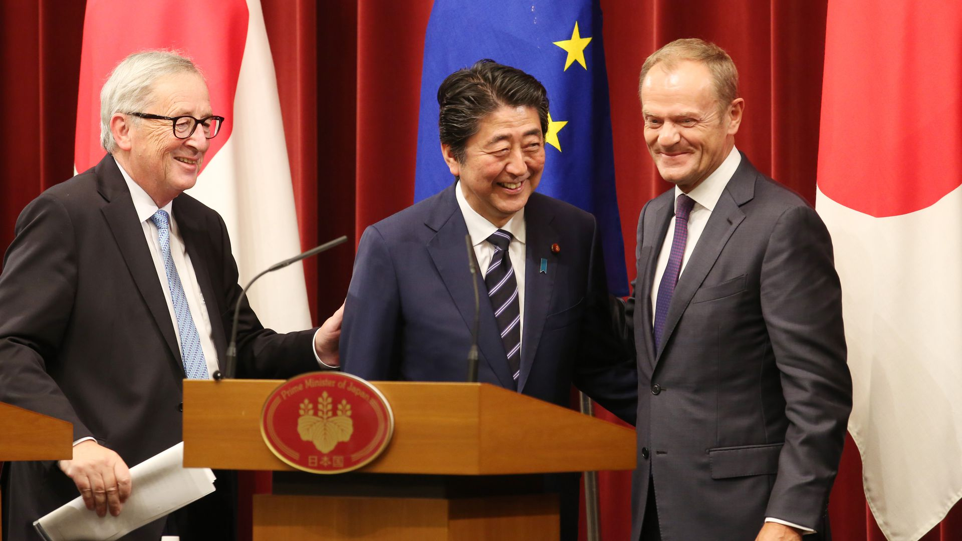 Japanese Prime Minister Shinzo Abe, European Commission President Jean-Claude Juncker and European Council President Donald Tusk at a joint press conference on the trade deal.