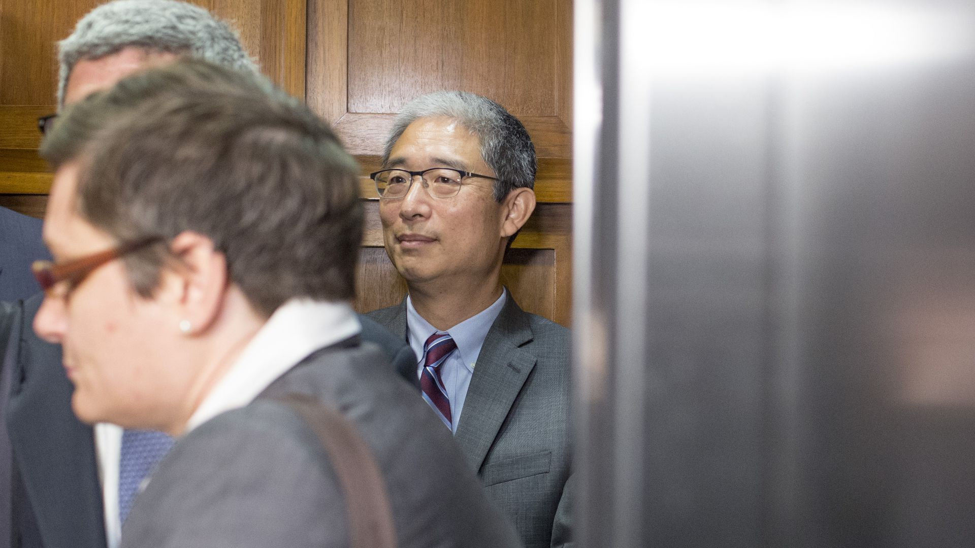 Bruce Ohr standing behind other men.