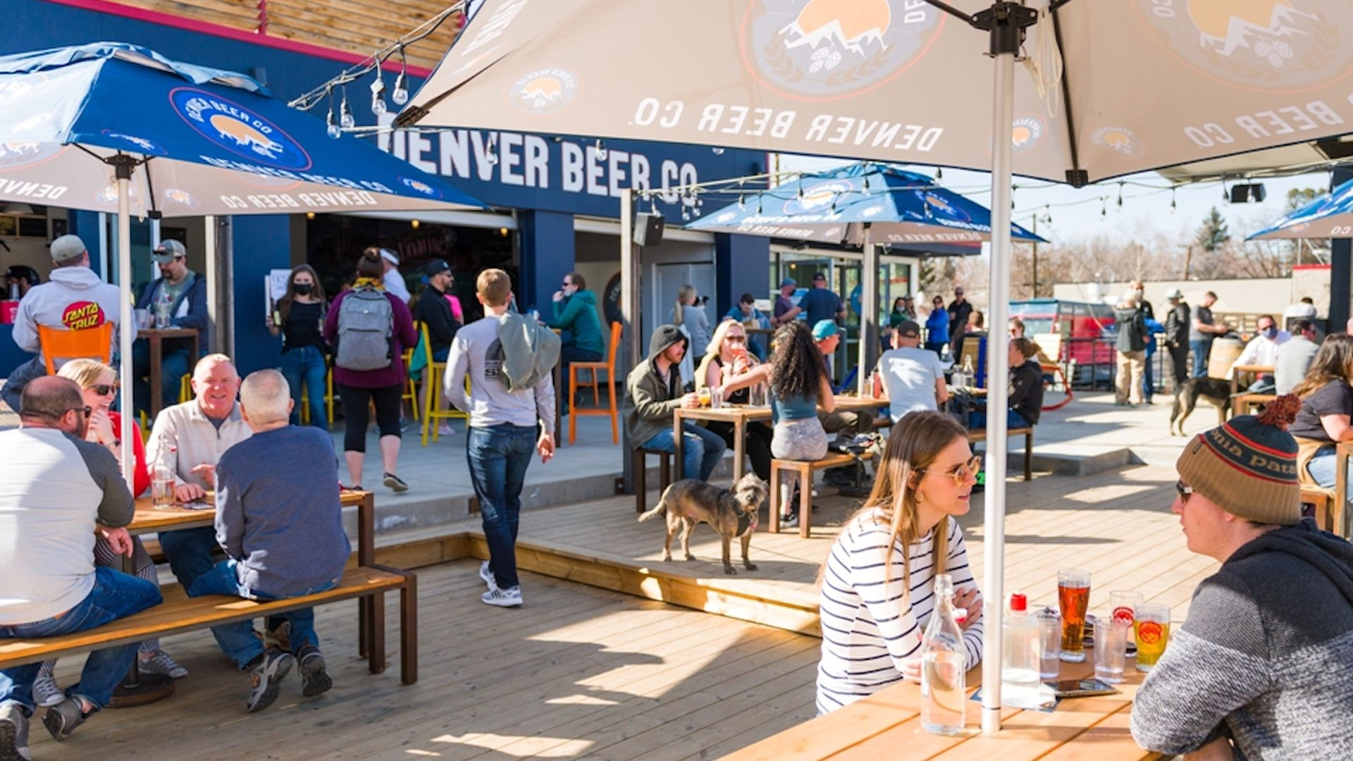 People sit outside at Denver Beer Co.'s new taproom on South Downing Street. Photo courtesy of Denver Beer Co.