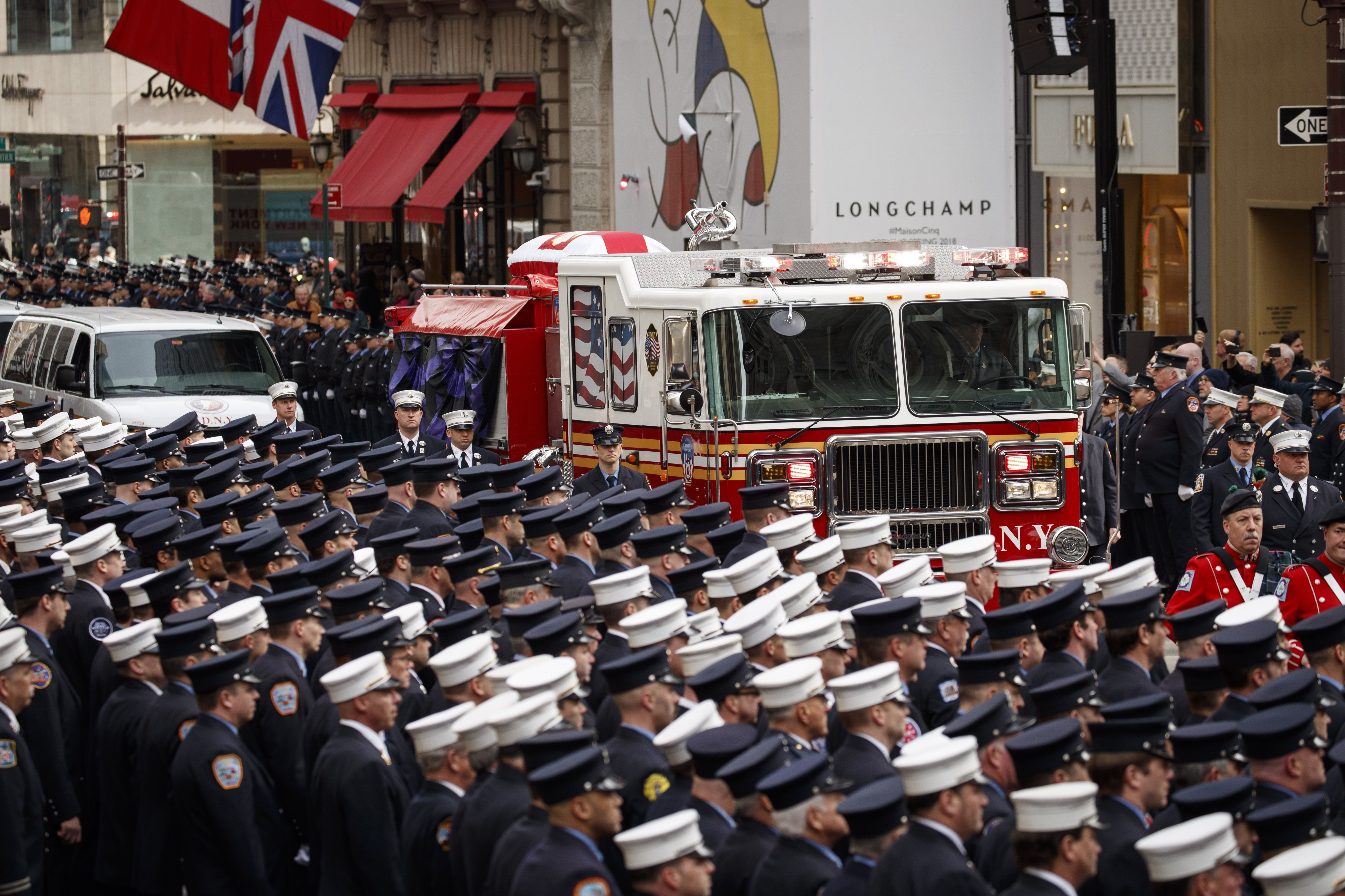 A procession with a fire truck