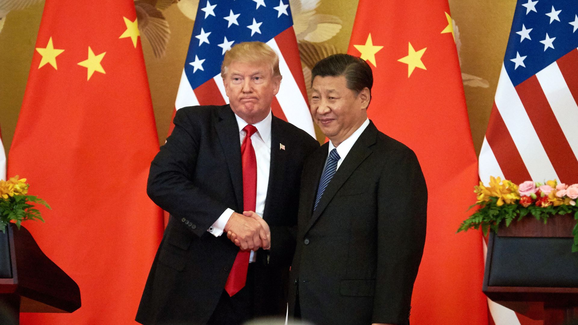 Trump and Xi shake hands.