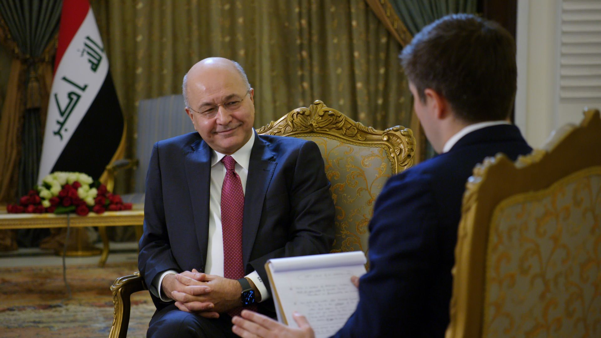Iraqi President Barham Salih smiles as he gives an interview