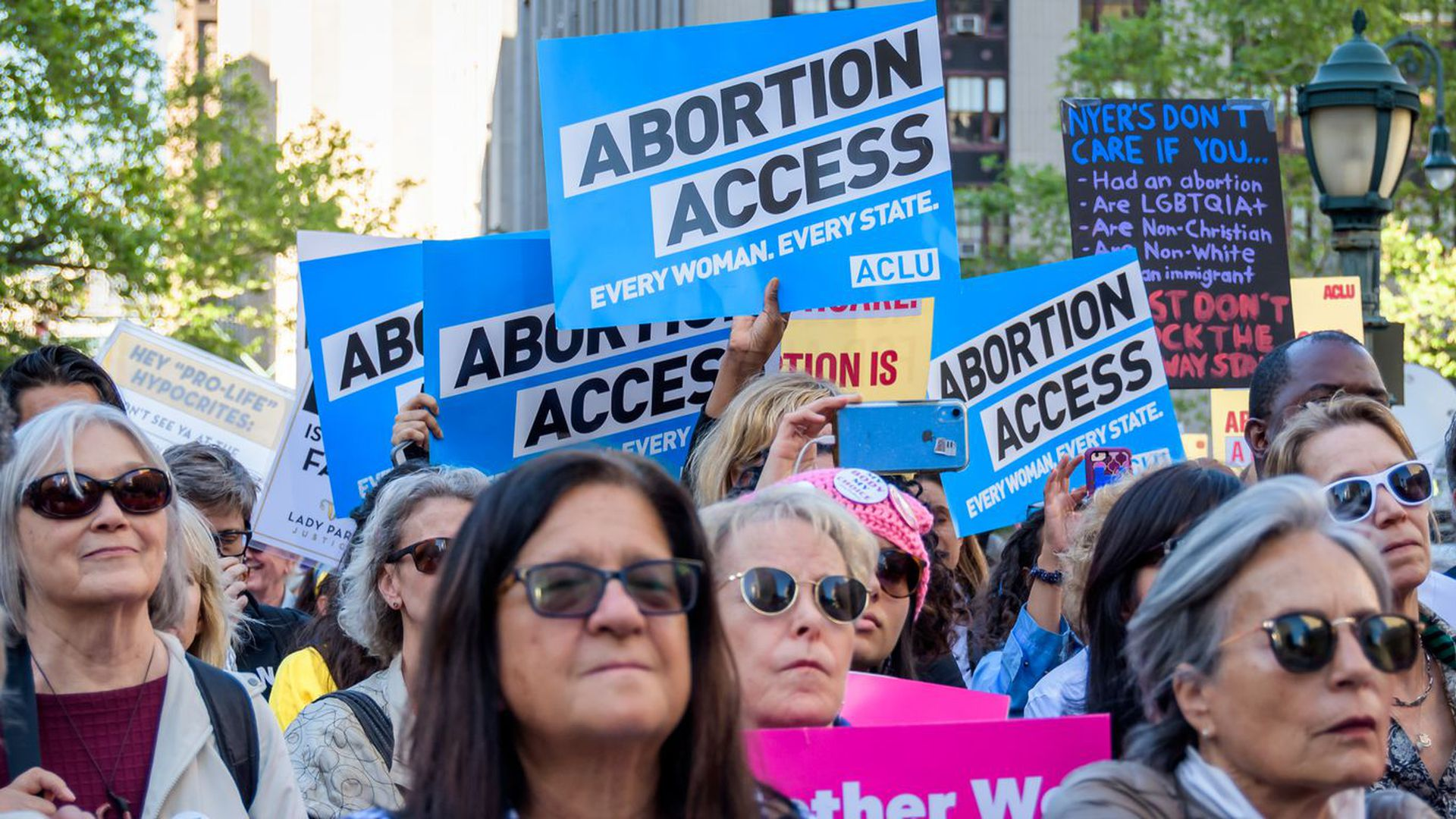Pro-abortion rights protesters rally.