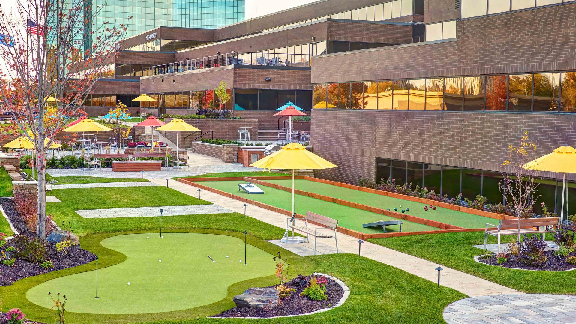 The exterior of the 7700 France building, which has a new patio with a putting green and lawn games.